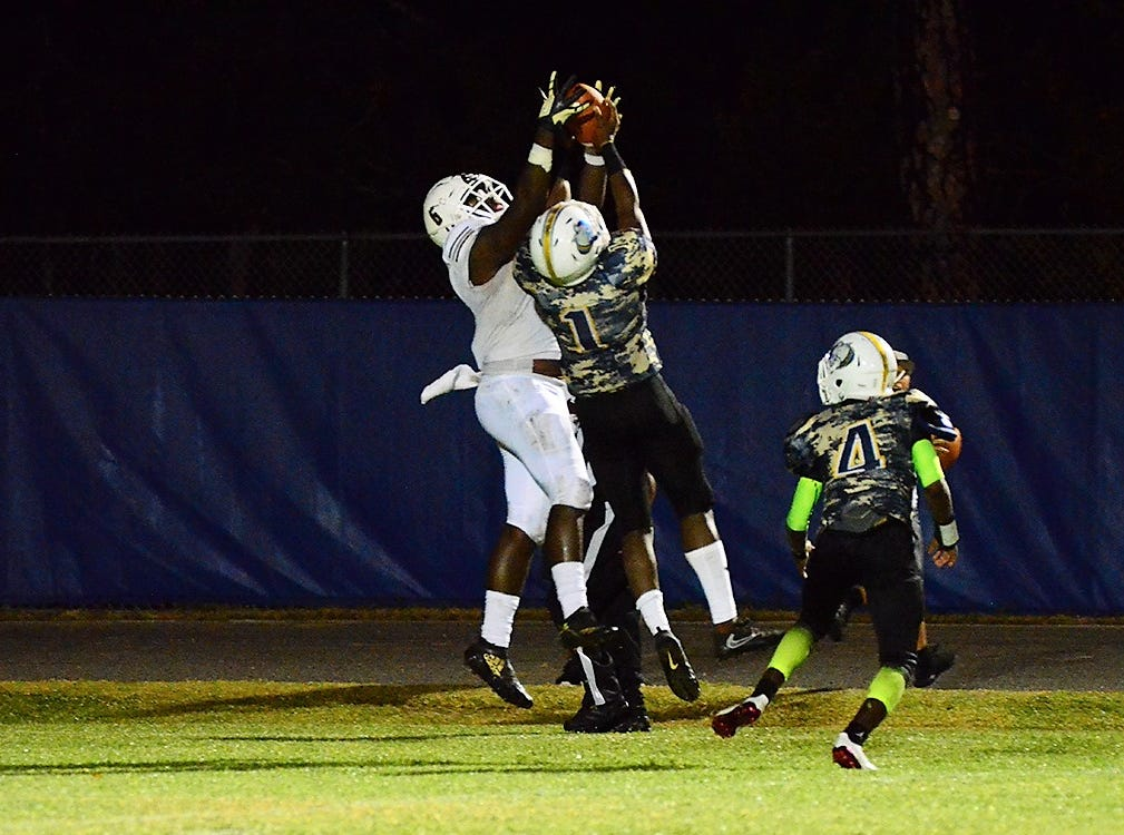 Astronaut's Louis Arnold III was able to pull down this pass over Kionte Curry for a touchdown Friday night in the yearly matchup between the War Eagles and the Terriers.