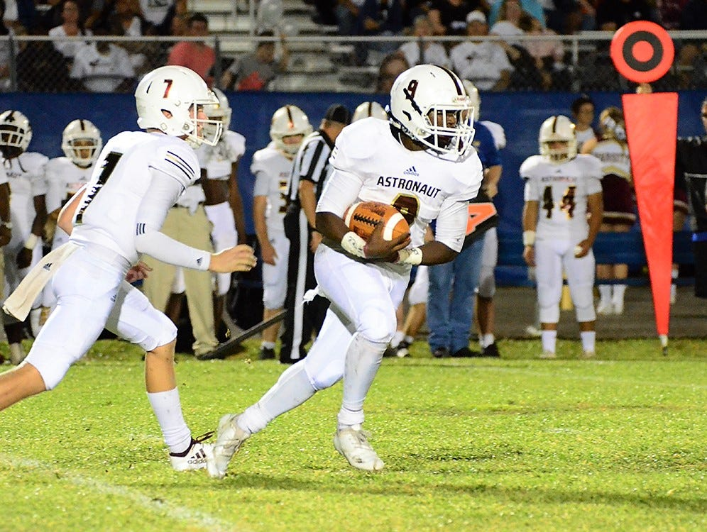 Trey Highsmith looks for a seam in the offensive line Friday night as Astronaut visited Titusville in their crosstown rivalry game.