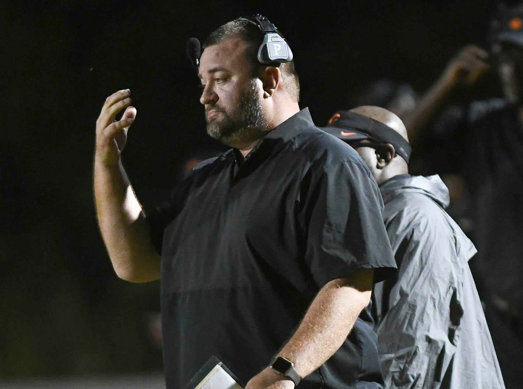Cocoa football coach Ryan Schneider gestures to his team during Friday's game.