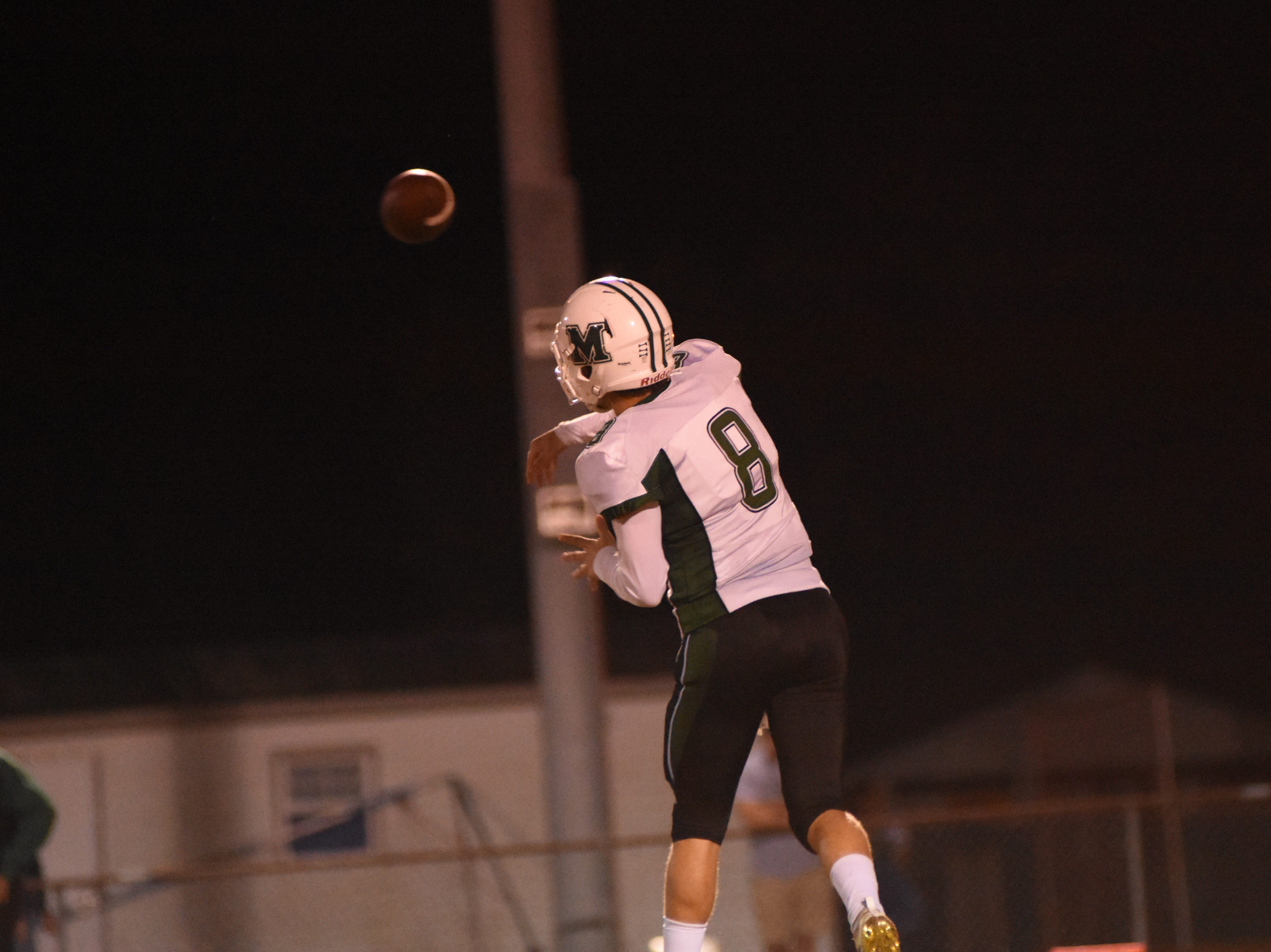 Mel High quarterback Justin Popovich (8) throws a pass during the second quarter.
