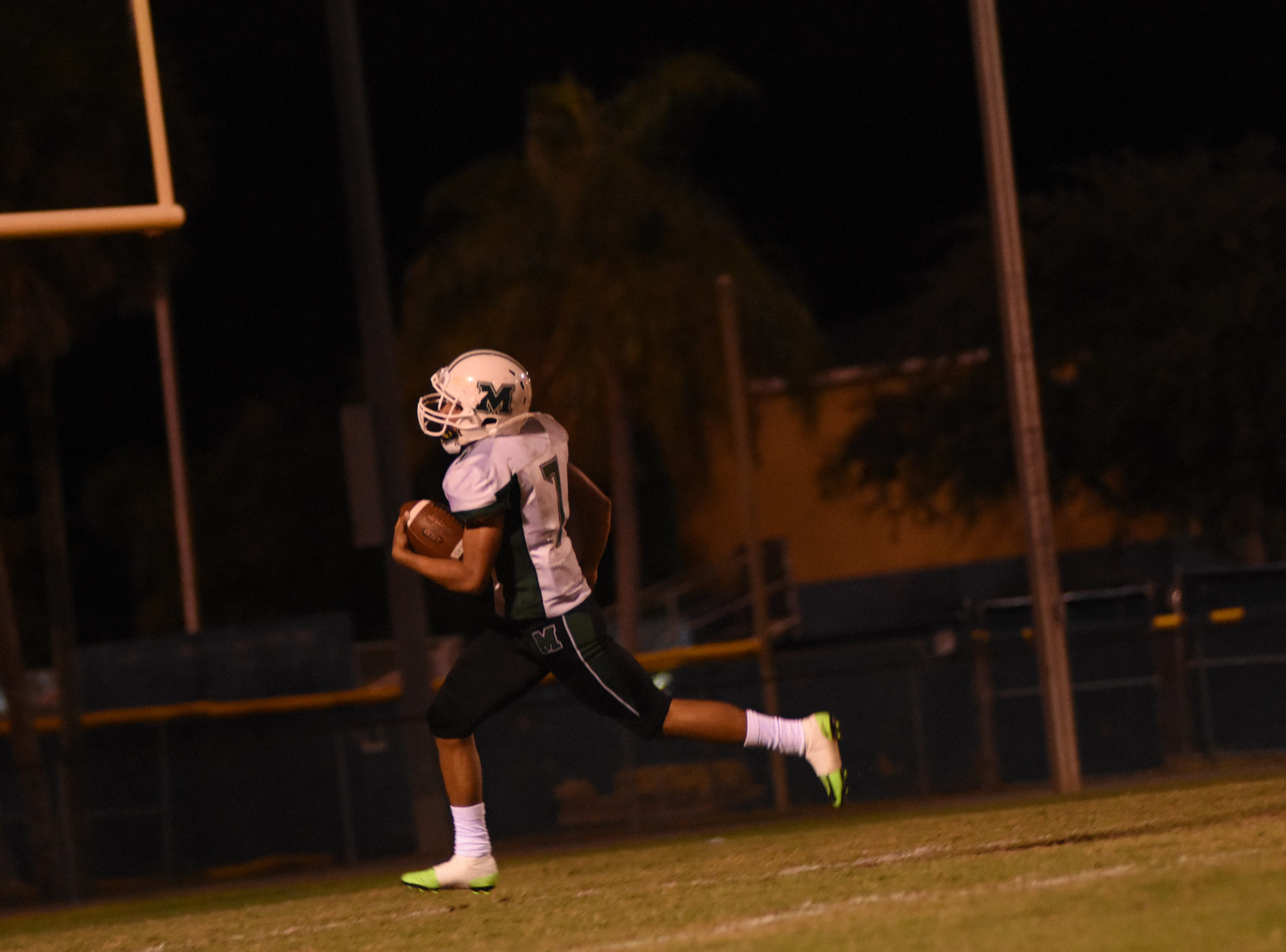 Antionio Wright Jr. (7) crosses into the end zone for his second touchdown of the night.