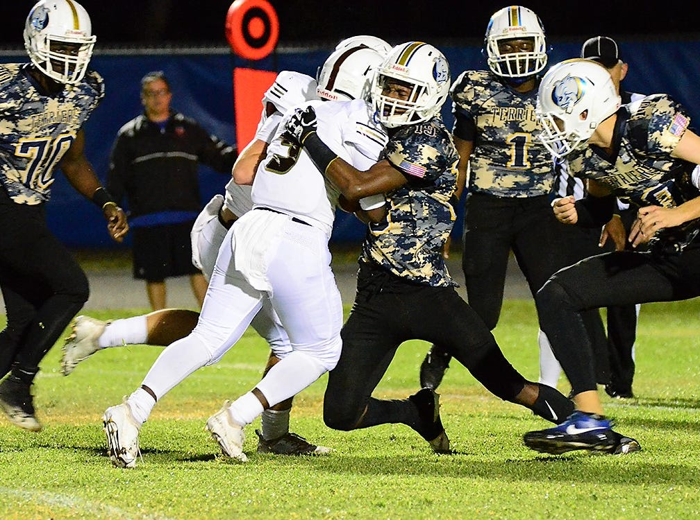 A moving force and an opposing force in Trey Highsmith of Astronaut and Deontae Howard of Titusville on Friday night.