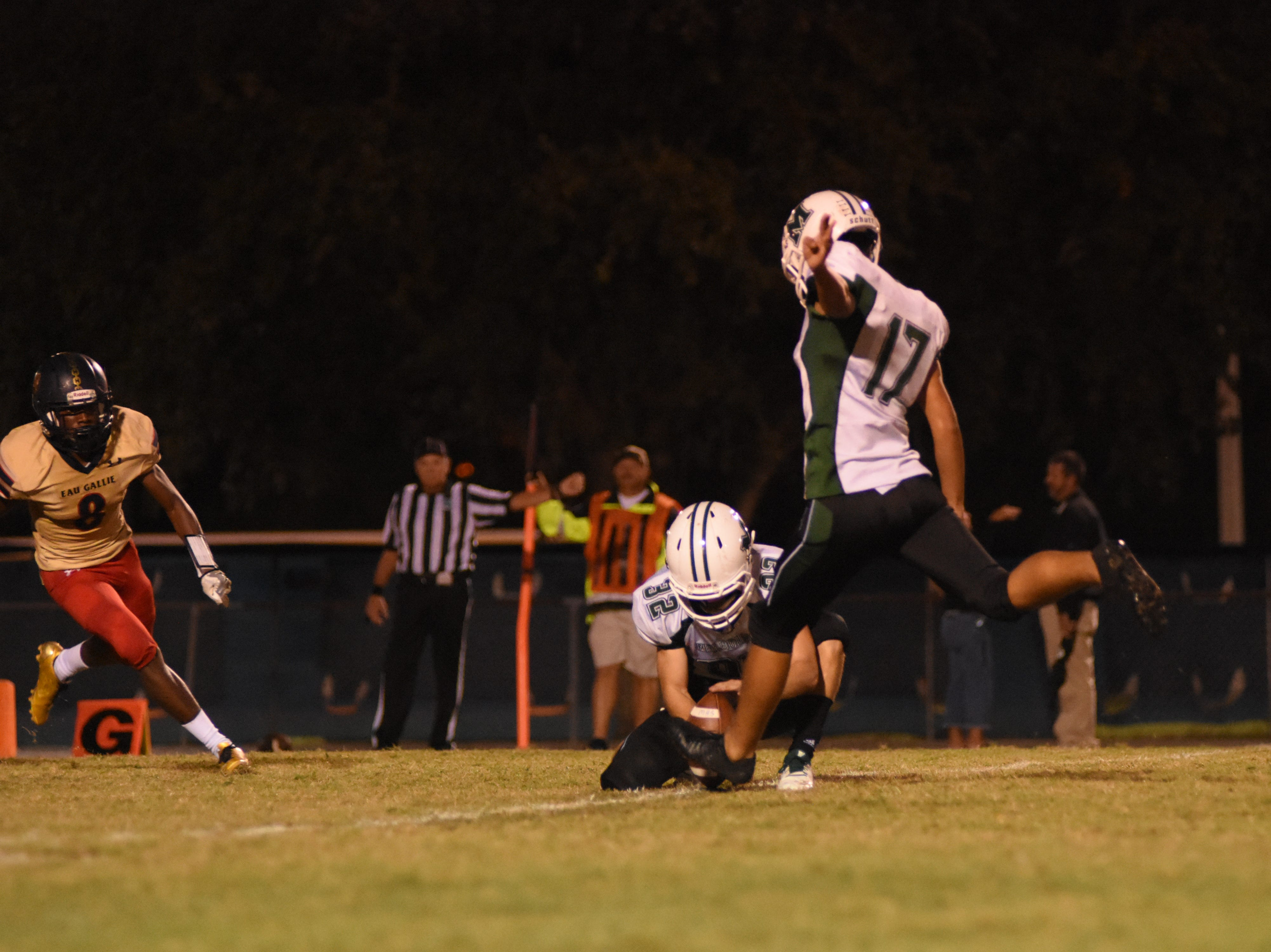 Melbourne High kicker Nick Martinez (17) kicks an extra point during the second quarter.