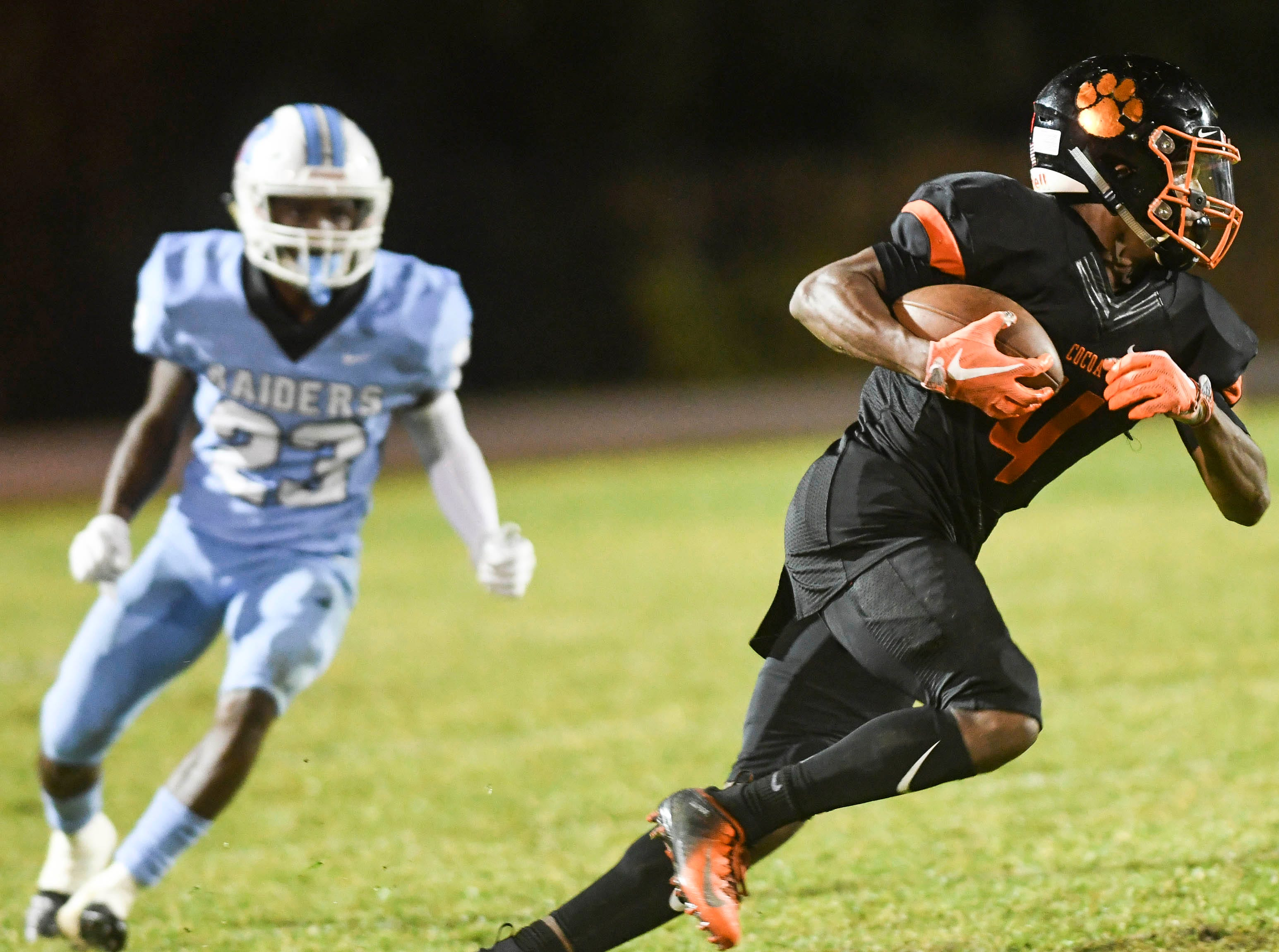 Cocoa's Willie Gaines runs the ball during Friday's game against Rockledge.