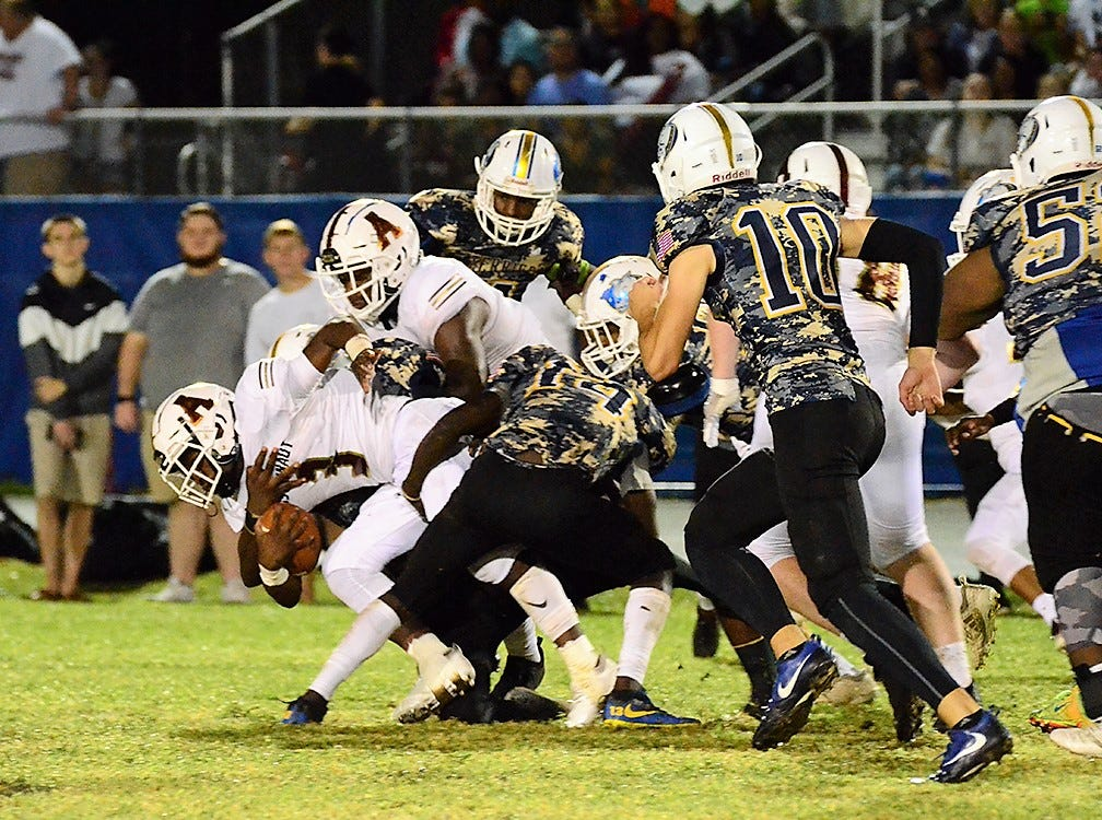 Abreon Torres carries the pack for a first down Friday night as the War Eagles visited Titusville in the crosstown rivalry.