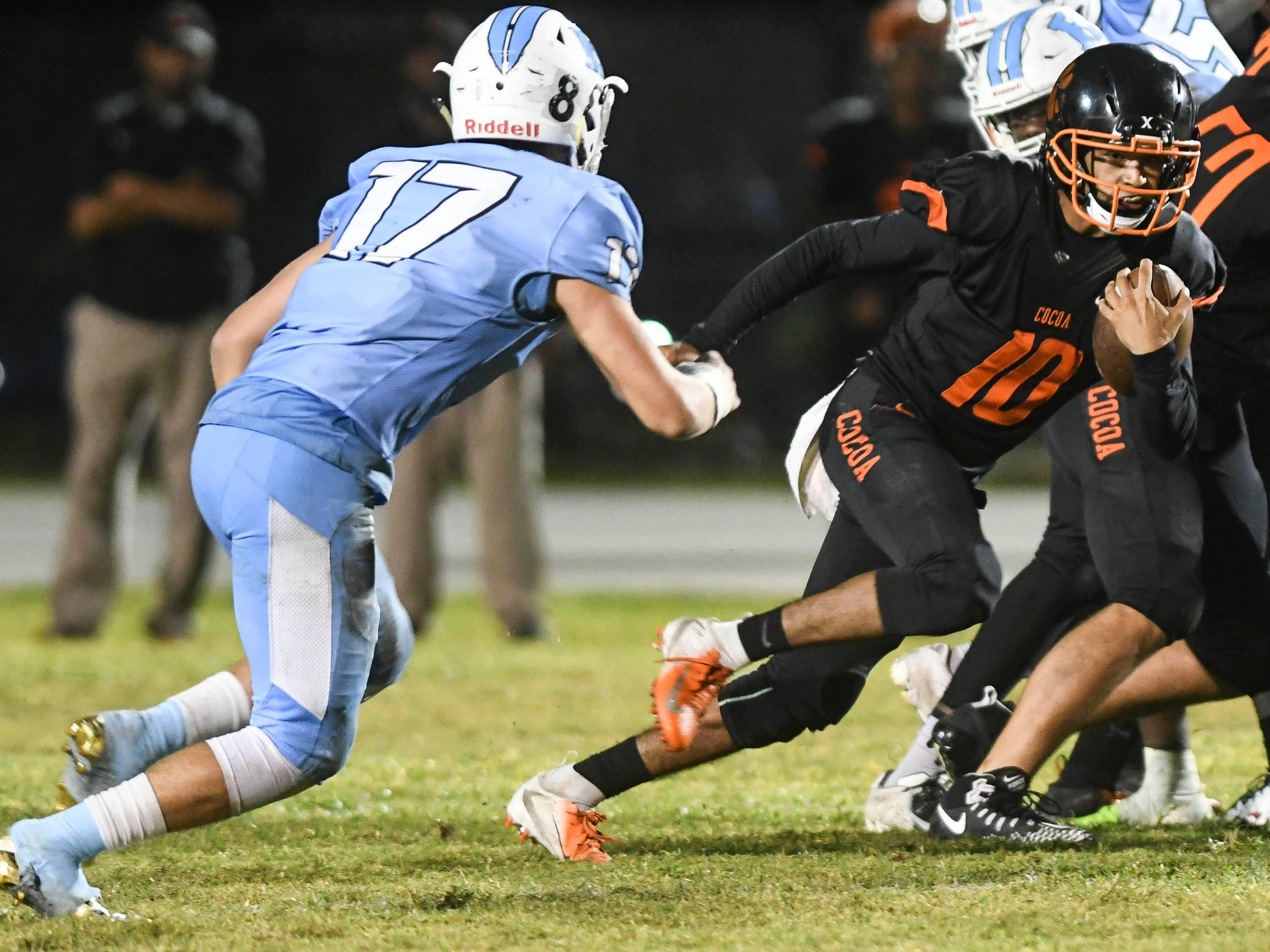 Cocoa QB Diego Arroyo (10) runs the ball during Friday's game against Rockledge.