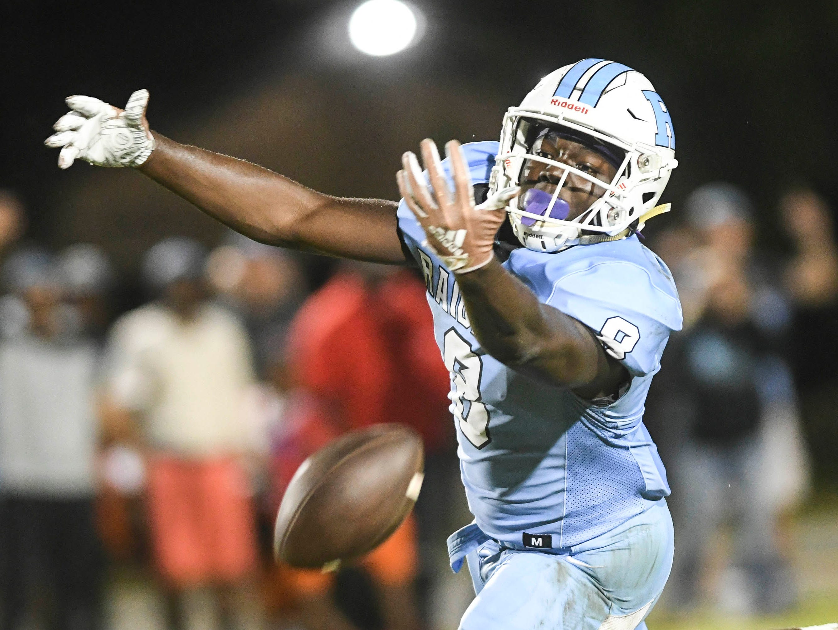 Rockledge's OC Brothers reaches out but can't quite bring in this pass during Friday's game against Cocoa.