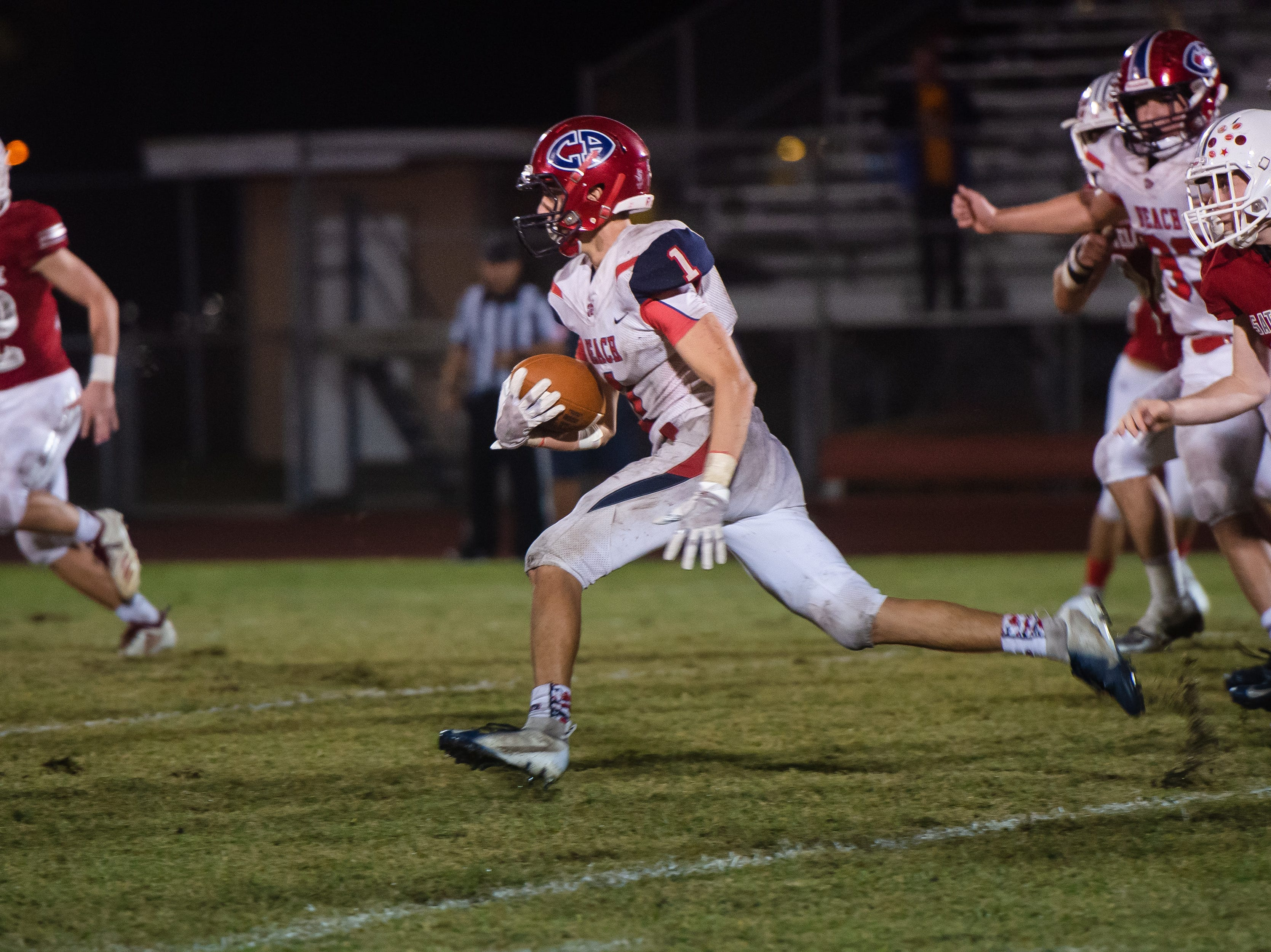 Ryan Tsarnas carries the ball for Cocoa Beach during the game against Satellite High.
