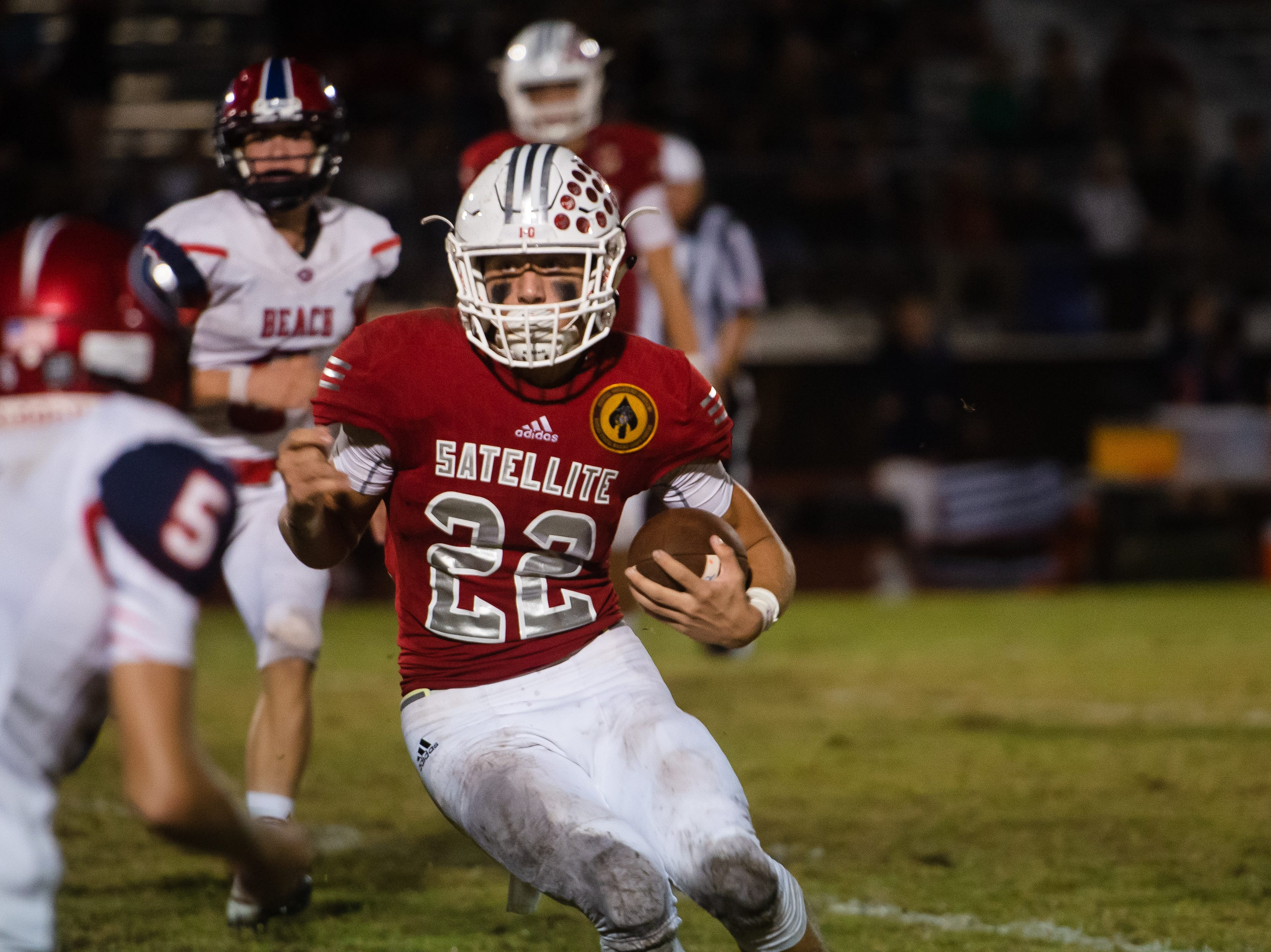 Satellite High's Max Hinkell carries the ball for Satellite during the game against Cocoa Beach.