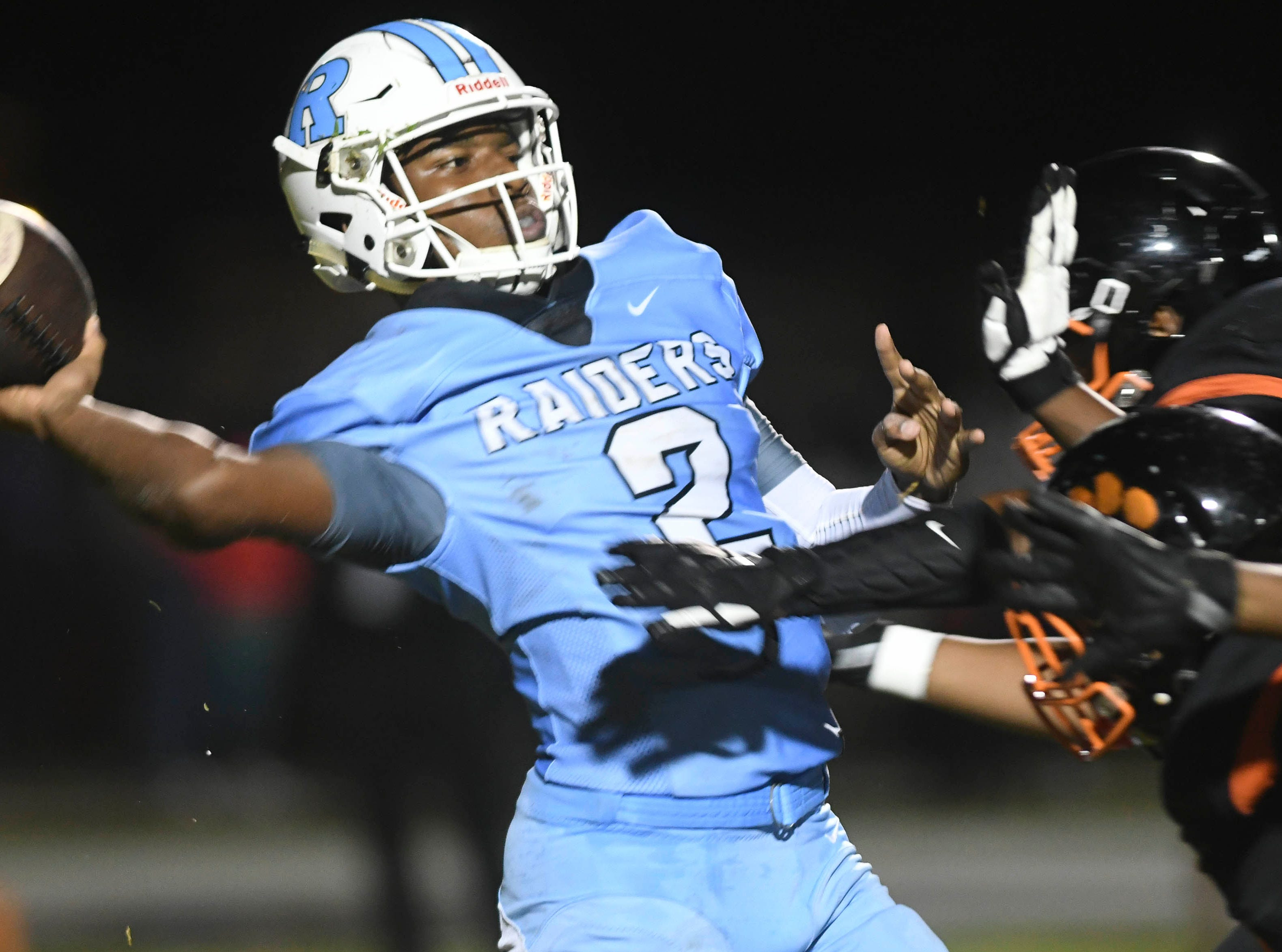 Rockledge QB Elias Allen is harassed by a pair of Cocoa defenders during Friday's game.