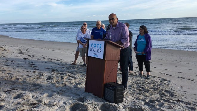 Sanjay Patel, the Democratic challenger against Rep. Bill Posey, R-Rockledge, for the U.S. House of Representatives District 8 seat, speaks about water and other environmental issues Saturday at Pelican Beach Park in Satellite Beach.