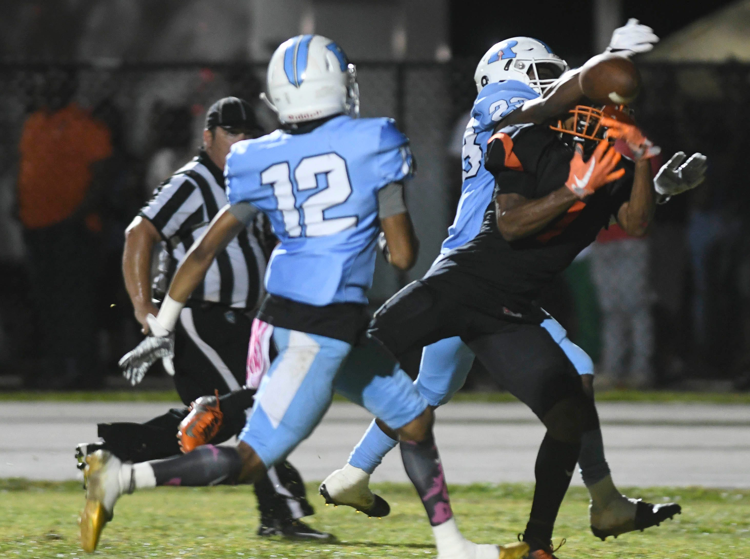 Shuntory Jordan (12) and Maurice Griffin of Rockledge keep Cocoa's Willie Gaines from catching this pass in the end zone during Friday's game.