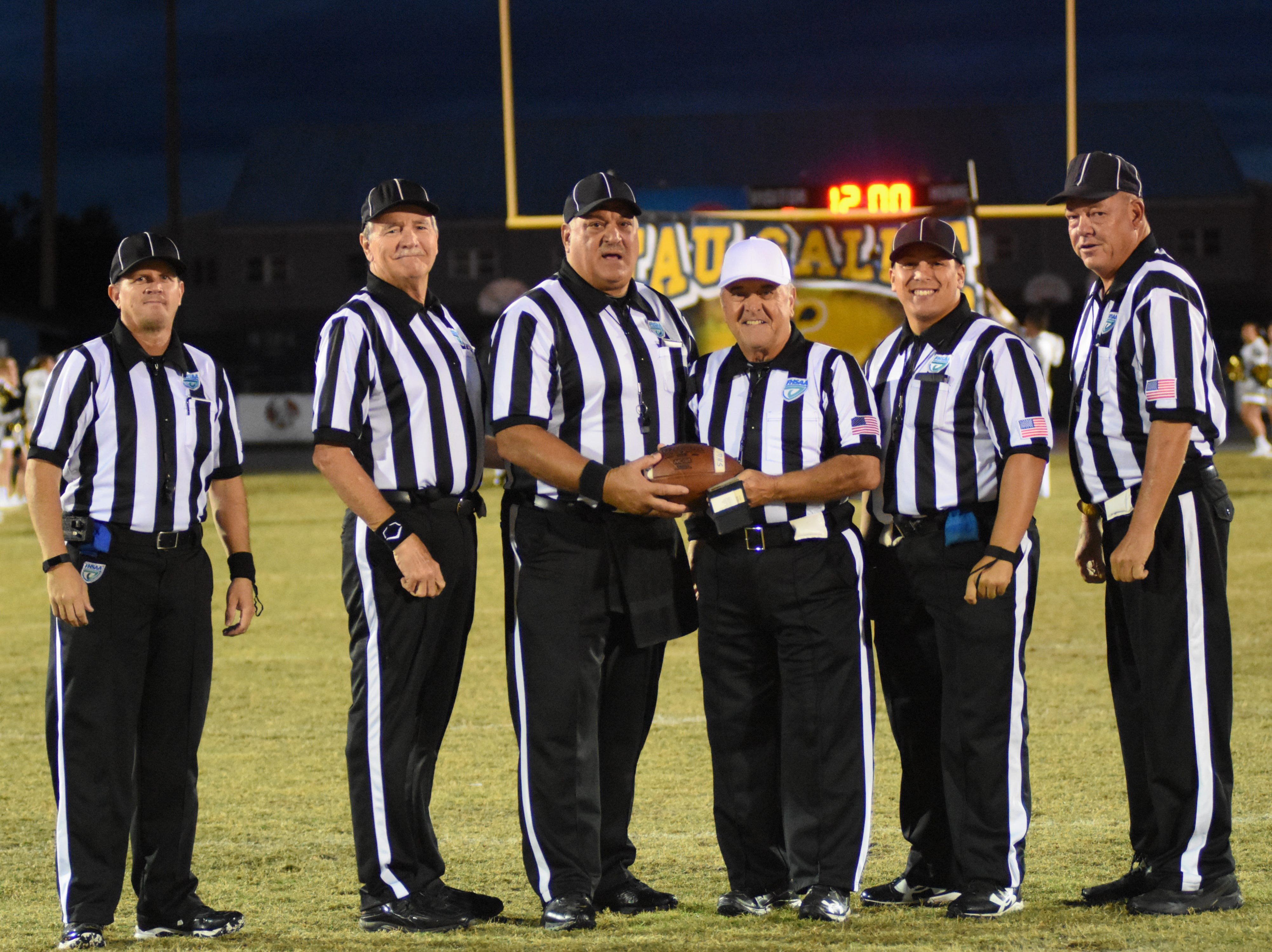 Friday Night's officials team pose for a photo.