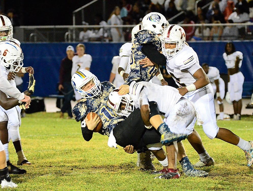Mike Henderson of Astronaut was able to get to Terrier quarterback Austin Gardner Friday night at Titusville.