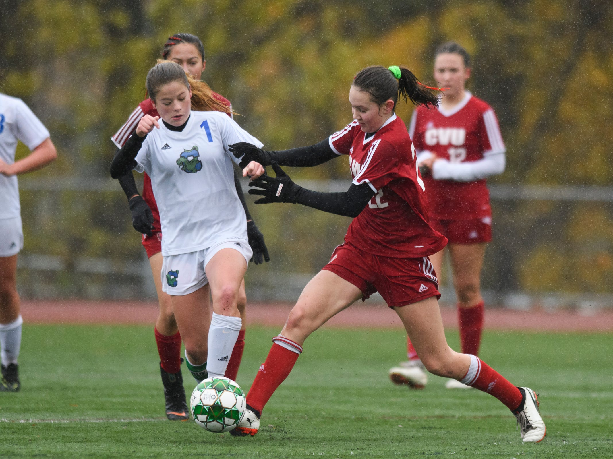 CVU's Josie Pecor (22) battles for the ball with Colchester's Madison Finelli (1) during the division I girls soccer championship game between the Colchester Lakers and the Champlain Valley Union Redhawks at Buck Hard Field on Saturday morning November 3, 2018 in Burlington.