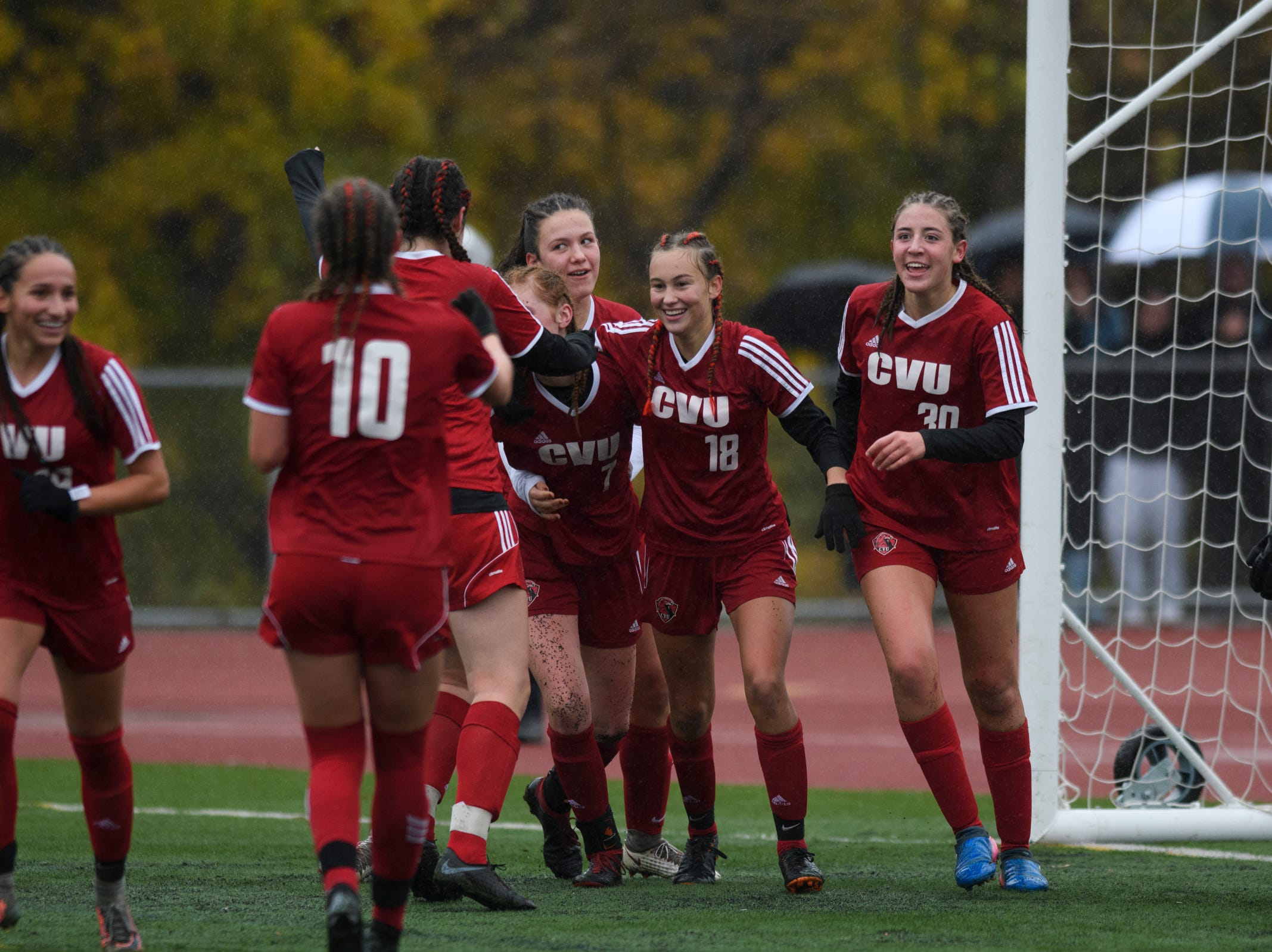 CVU celebrates a goal during the division I girls soccer championship game between the Colchester Lakers and the Champlain Valley Union Redhawks at Buck Hard Field on Saturday morning November 3, 2018 in Burlington.