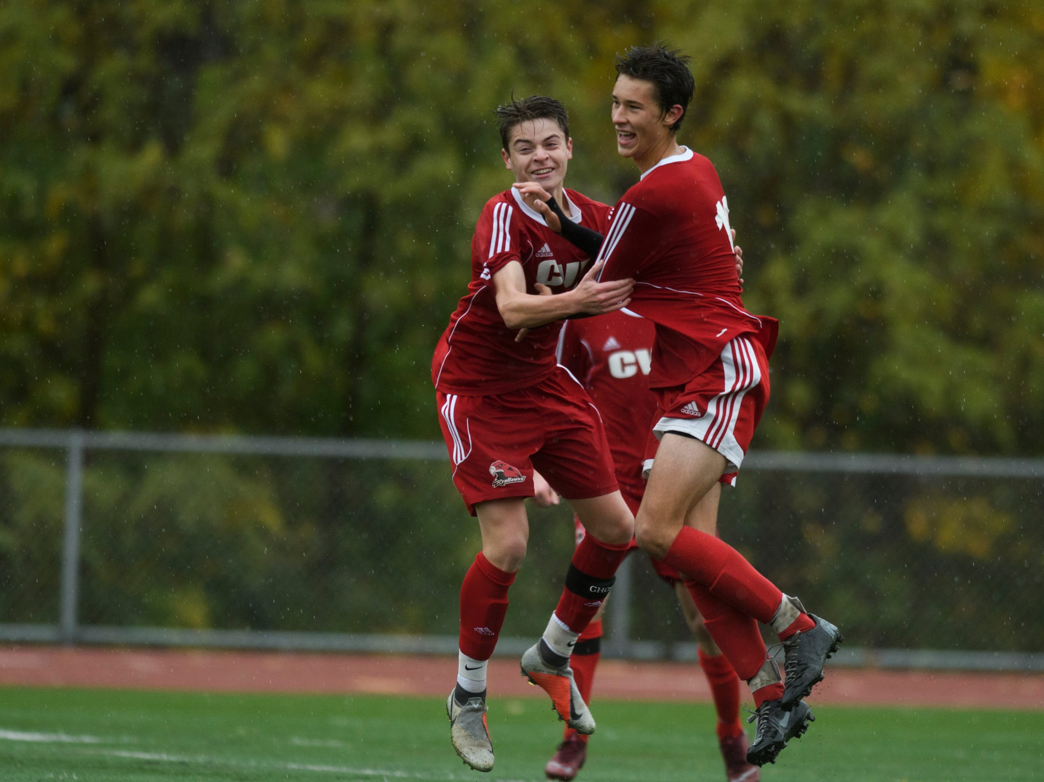 CVU celebrates the win during the Division I boys soccer championship game between the St. Johnsbury Hilltoppers and the Champlain Valley Union Redhawks at Buck Hard Field on Saturday morning November 3, 2018 in Burlington.