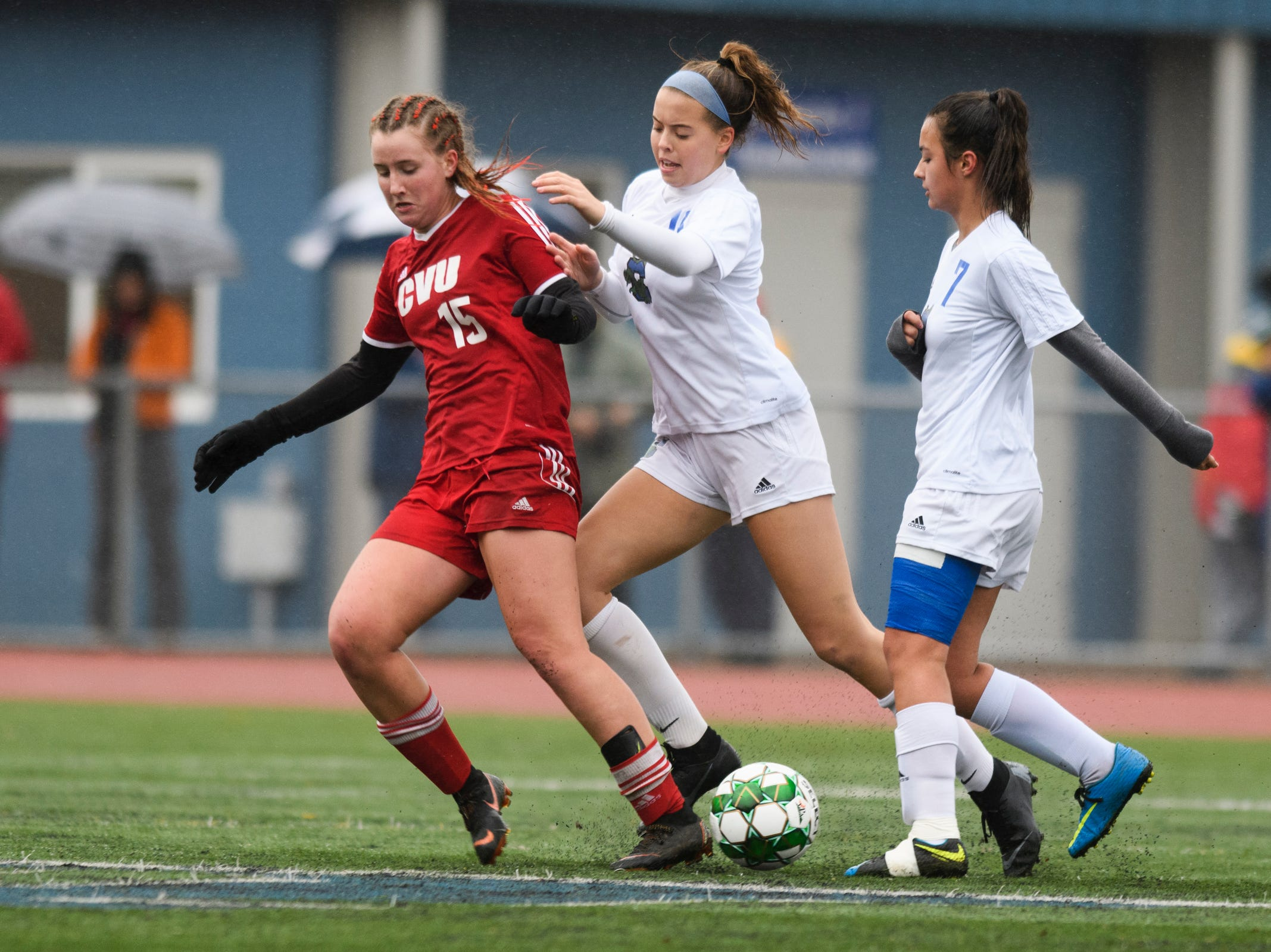 Colchester's Ellie Benoyre (16) battles for the ball with CVU's Olivia Morton (15) during the division I girls soccer championship game between the Colchester Lakers and the Champlain Valley Union Redhawks at Buck Hard Field on Saturday morning November 3, 2018 in Burlington.