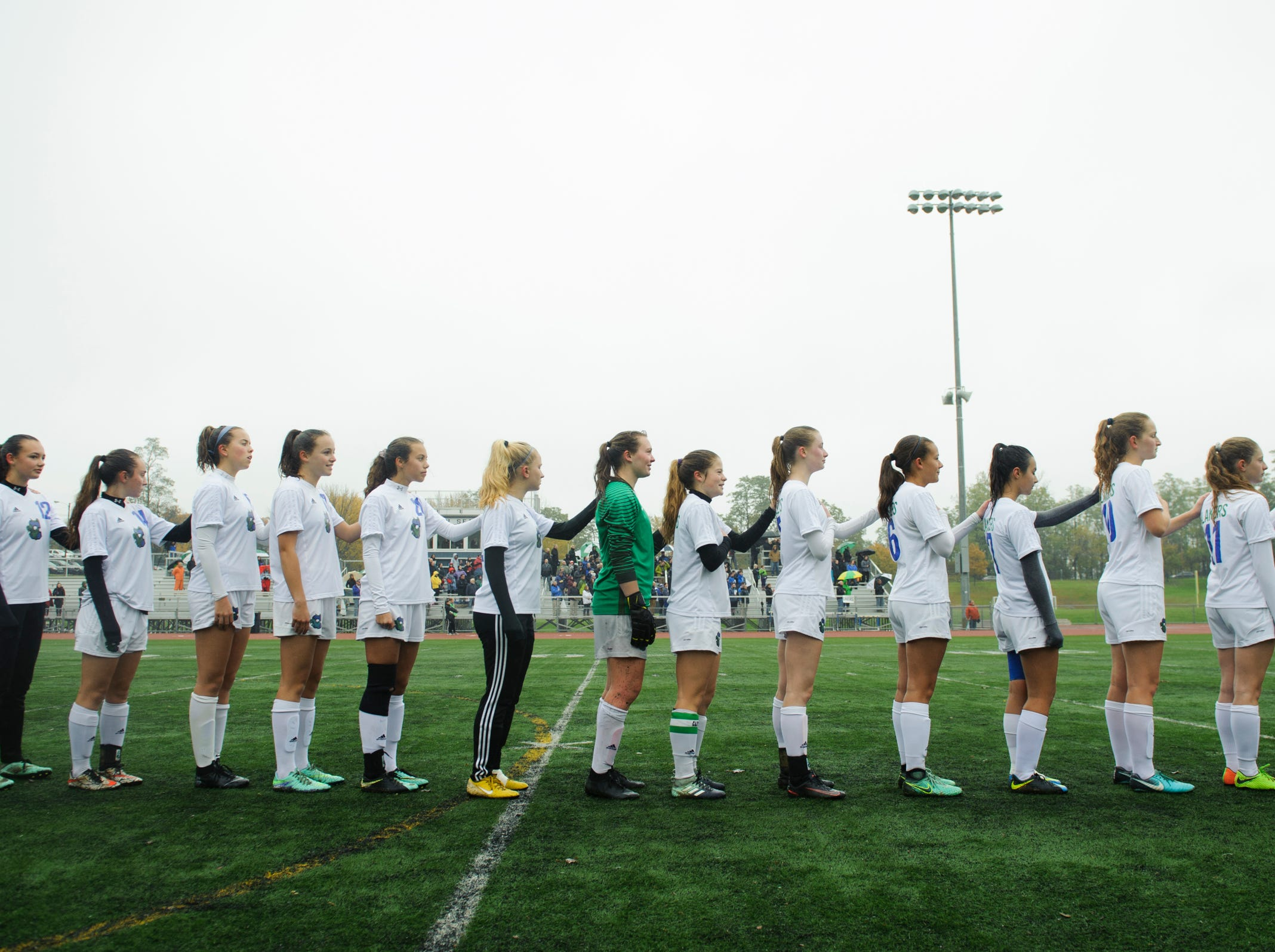Colchester listens to the National Anthem during the division I girls soccer championship game between the Colchester Lakers and the Champlain Valley Union Redhawks at Buck Hard Field on Saturday morning November 3, 2018 in Burlington.