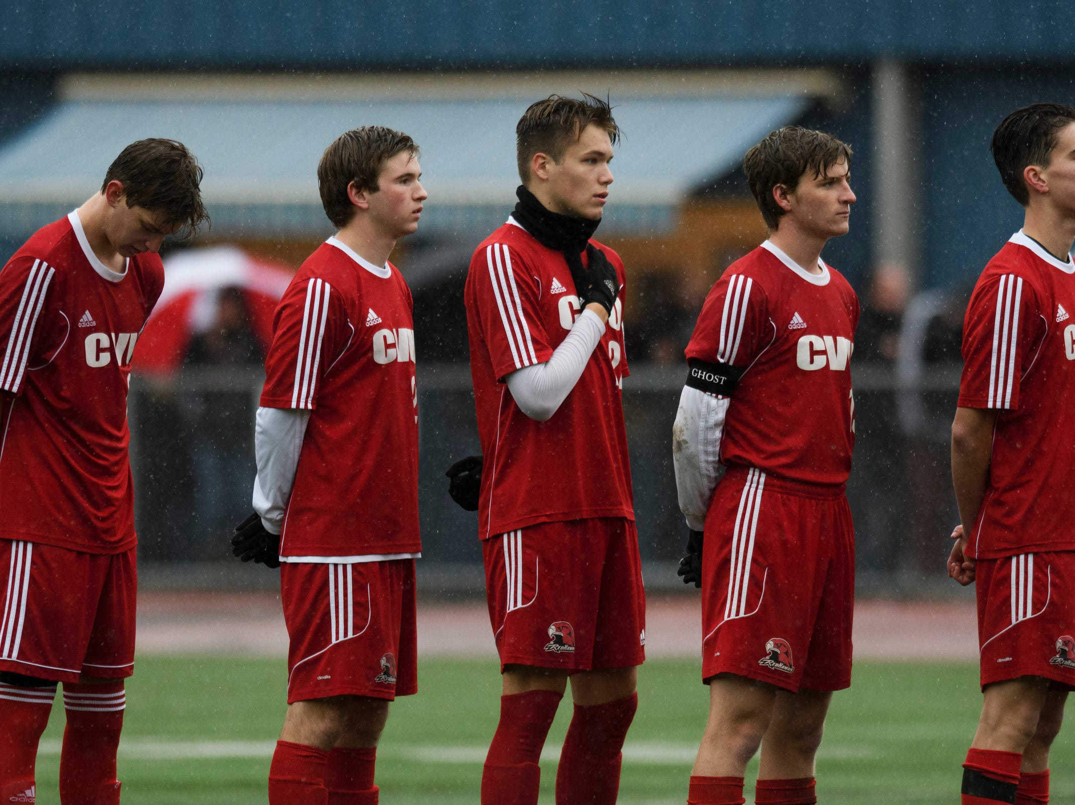 CVU listens to the National Anthem during the Division I boys soccer championship game between the St. Johnsbury Hilltoppers and the Champlain Valley Union Redhawks at Buck Hard Field on Saturday morning November 3, 2018 in Burlington.