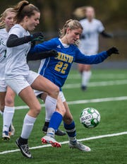 Rice #4 Emma Blanck battles Milton #22 Tatum Shappy during the Div. 2 Vermont State girl's high school soccer championship on Saturday, Nov. 3, 2018, at South Burlington High School. Milton won the championship in sudden-death overtime, 2-1.