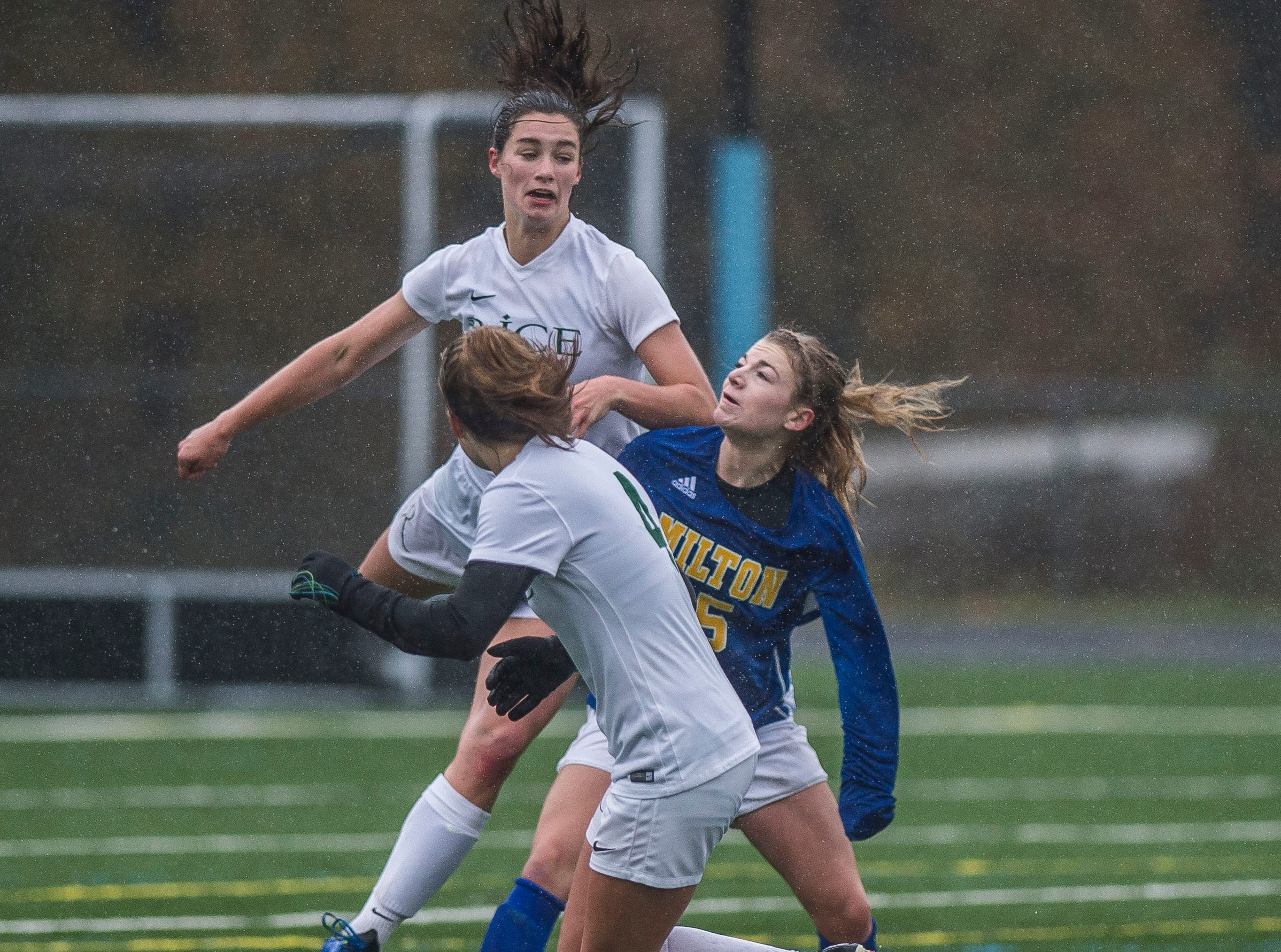 Milton #15 Emma Wennar gets caught between Rice #12  Petra Langan and #4 Emma Blanck during the Div. 2 Vermont State girl's high school soccer championship on Saturday, Nov. 3, 2018, at South Burlington High School. Milton won the championship in sudden-death overtime, 2-1.