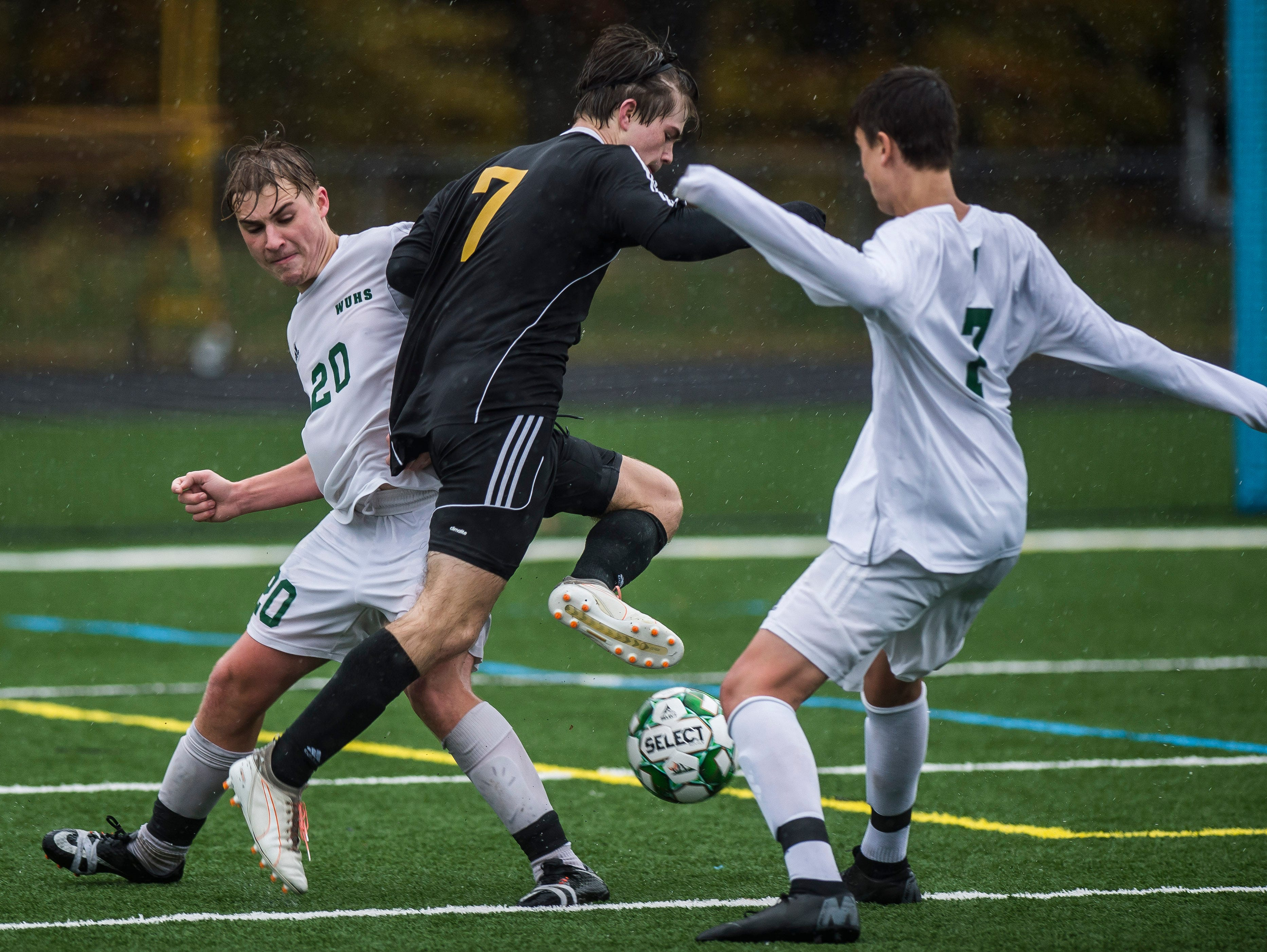 Hardwood #7 Hayden Adams splits Woodstock #20 Lucas Piconi and #7 Harrison Morse during their Div. 2 Vermont State high school boy's soccer championship game at South Burlington High School on Saturday, Nov. 3, 2018. Hardwood Union won, 3-0.