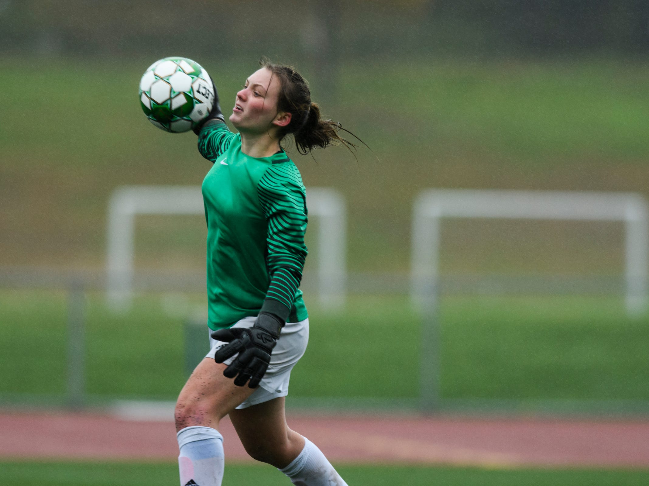 Colchester goalie Olivia Moore throws the ball to a teammate during the division I girls soccer championship game between the Colchester Lakers and the Champlain Valley Union Redhawks at Buck Hard Field on Saturday morning November 3, 2018 in Burlington.
