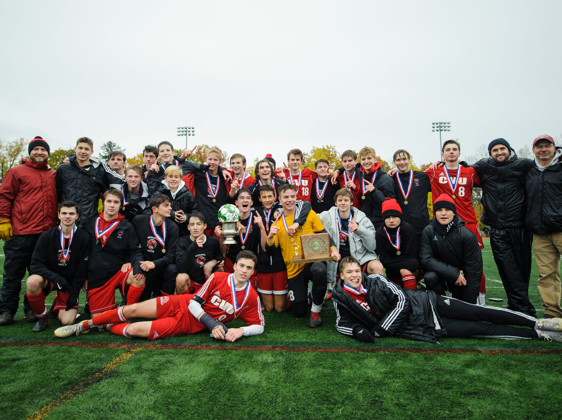 CVU poses for a group picture at the conclusion of the Division I boys soccer championship game between the St. Johnsbury Hilltoppers and the Champlain Valley Union Redhawks at Buck Hard Field on Saturday morning November 3, 2018 in Burlington.