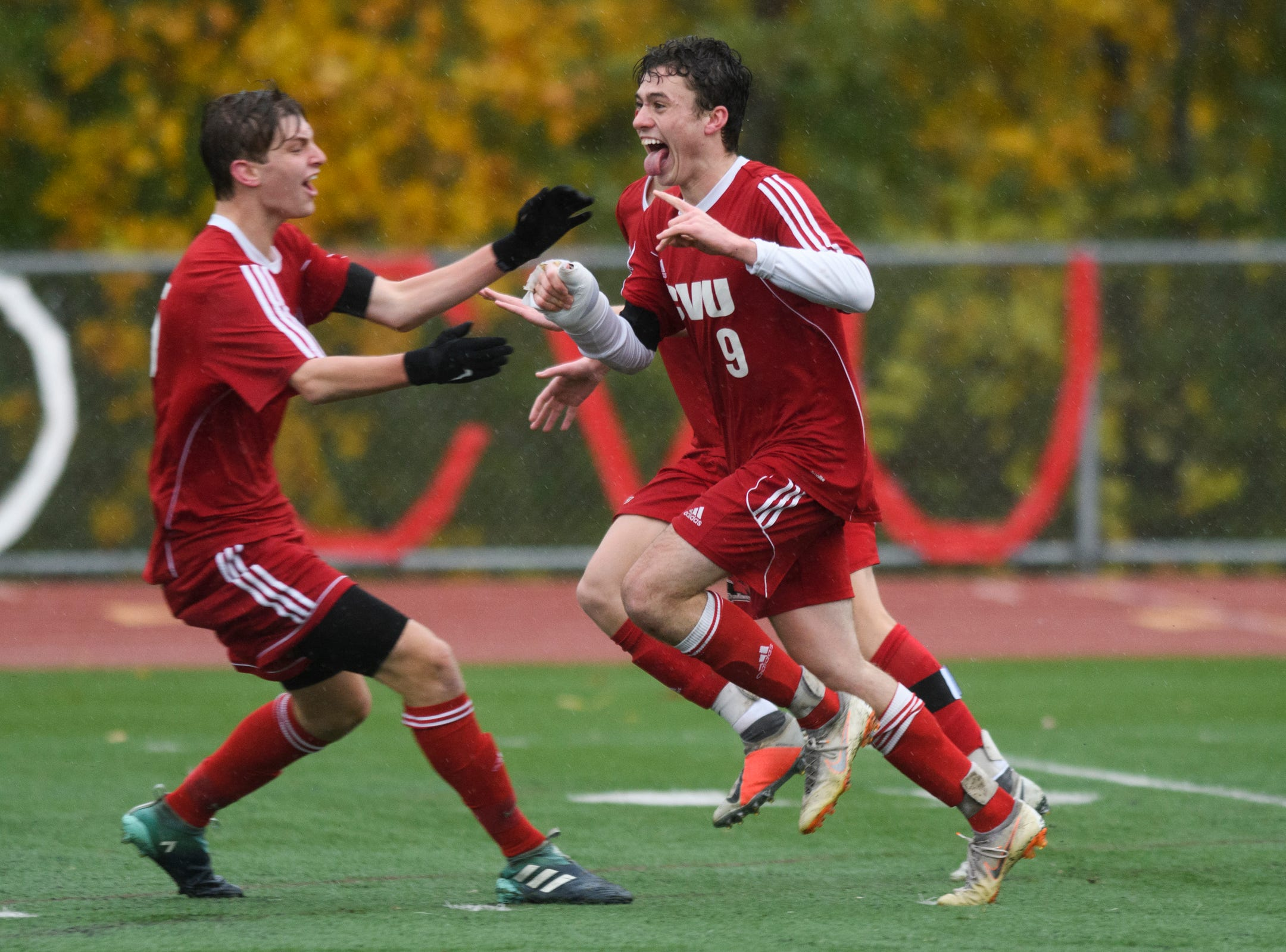 CVU's Jonah Roberts (9) and Enzo Delia (8) celebrate a goal during the Division I boys soccer championship game between the St. Johnsbury Hilltoppers and the Champlain Valley Union Redhawks at Buck Hard Field on Saturday morning November 3, 2018 in Burlington.