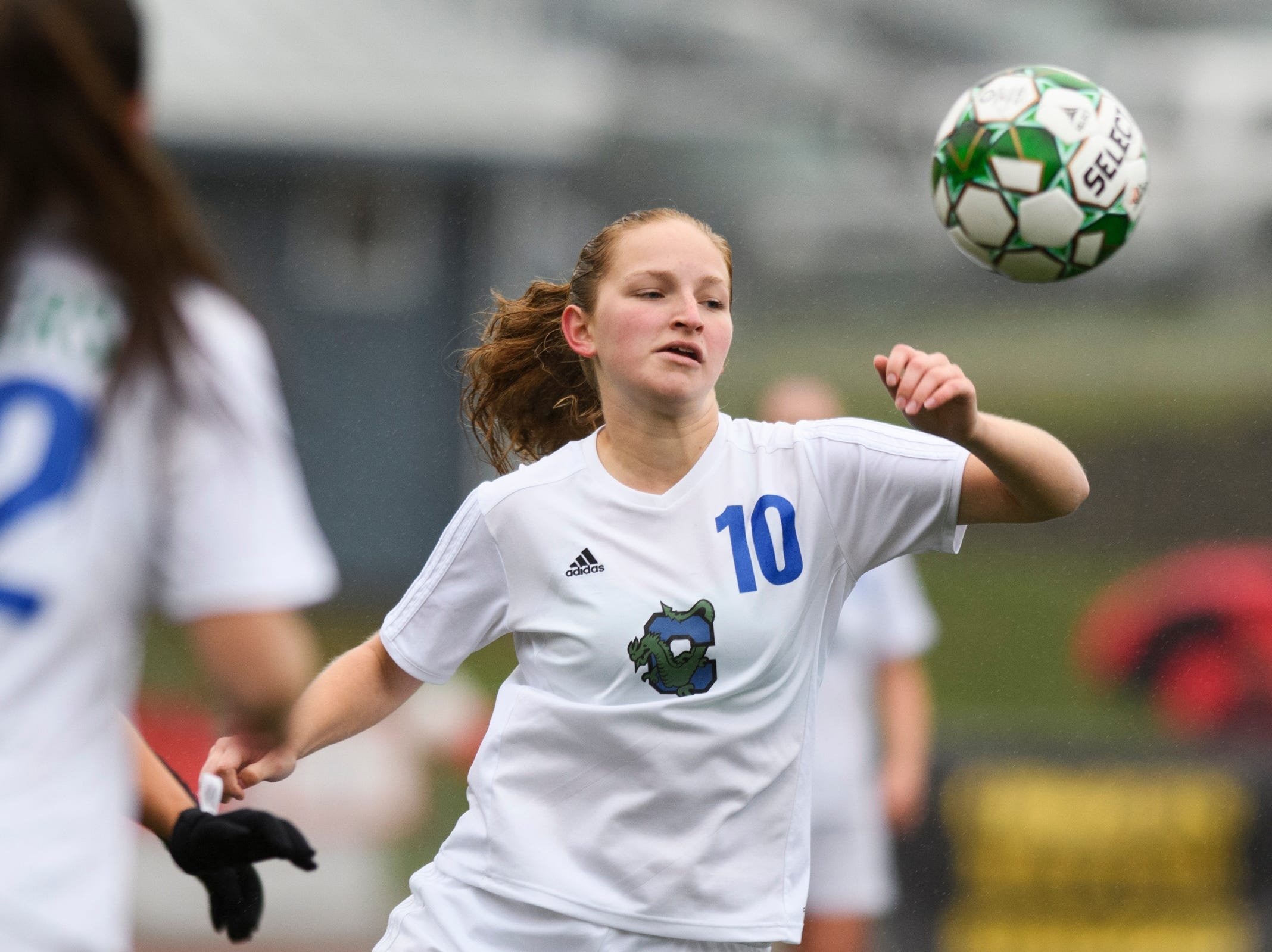 Colchester's Ava Hayes (10) plays the ball during the division I girls soccer championship game between the Colchester Lakers and the Champlain Valley Union Redhawks at Buck Hard Field on Saturday morning November 3, 2018 in Burlington.