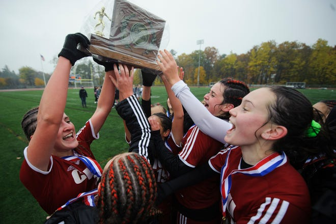 Champlain Valley players celebrate following their 1-0 win in the Division I during the division I girls soccer championship game between the Colchester Lakers and the Champlain Valley Union Redhawks at Buck Hard Field on Saturday morning November 3, 2018 in Burlington.
