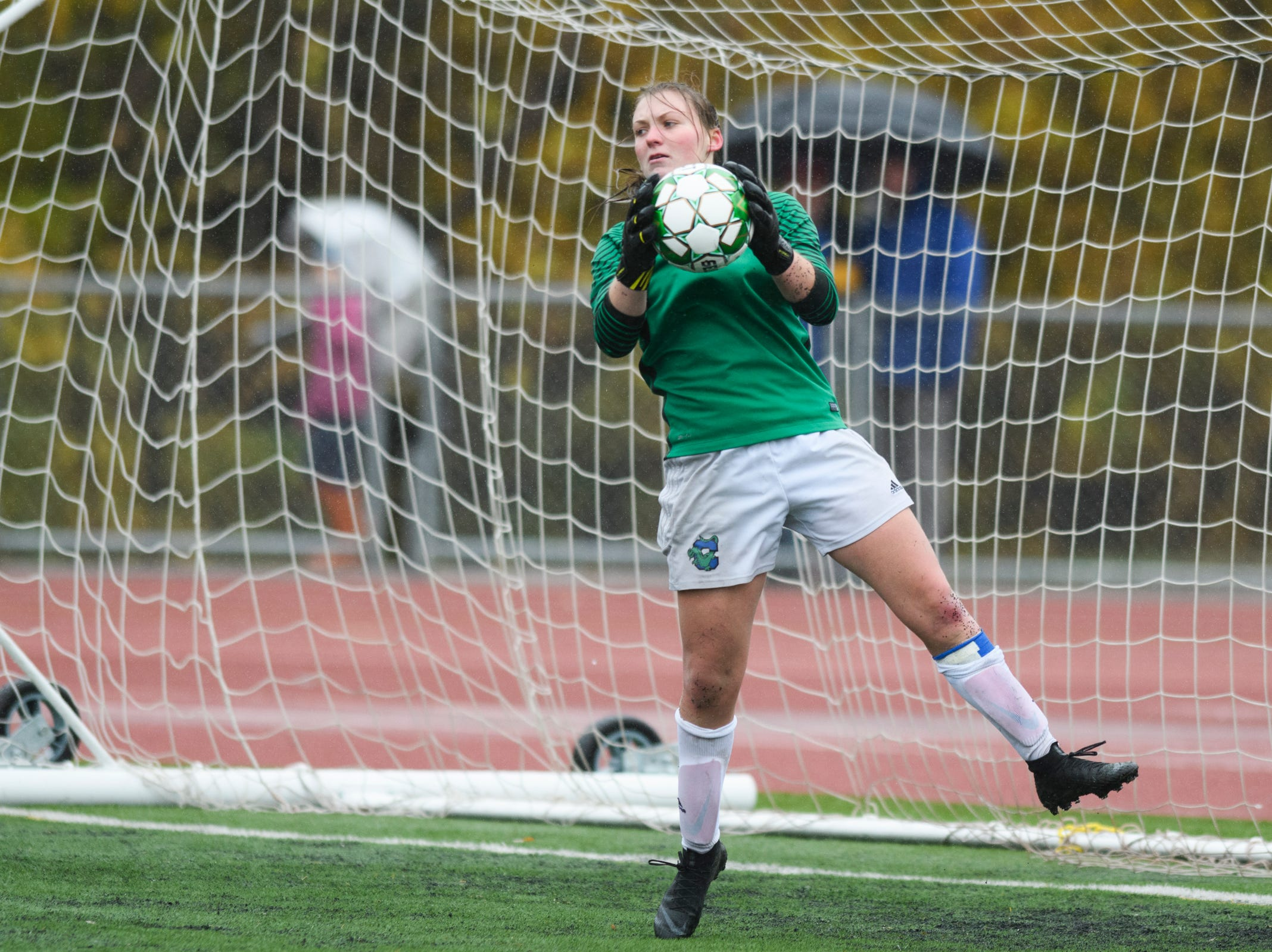 Colchester goalie Olivia Moore makes a save during the division I girls soccer championship game between the Colchester Lakers and the Champlain Valley Union Redhawks at Buck Hard Field on Saturday morning November 3, 2018 in Burlington.