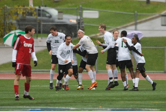 St. Johnsbury celebrates a goal during the Division I boys soccer championship game between the St. Johnsbury Hilltoppers and the Champlain Valley Union Redhawks at Buck Hard Field on Saturday morning November 3, 2018 in Burlington.