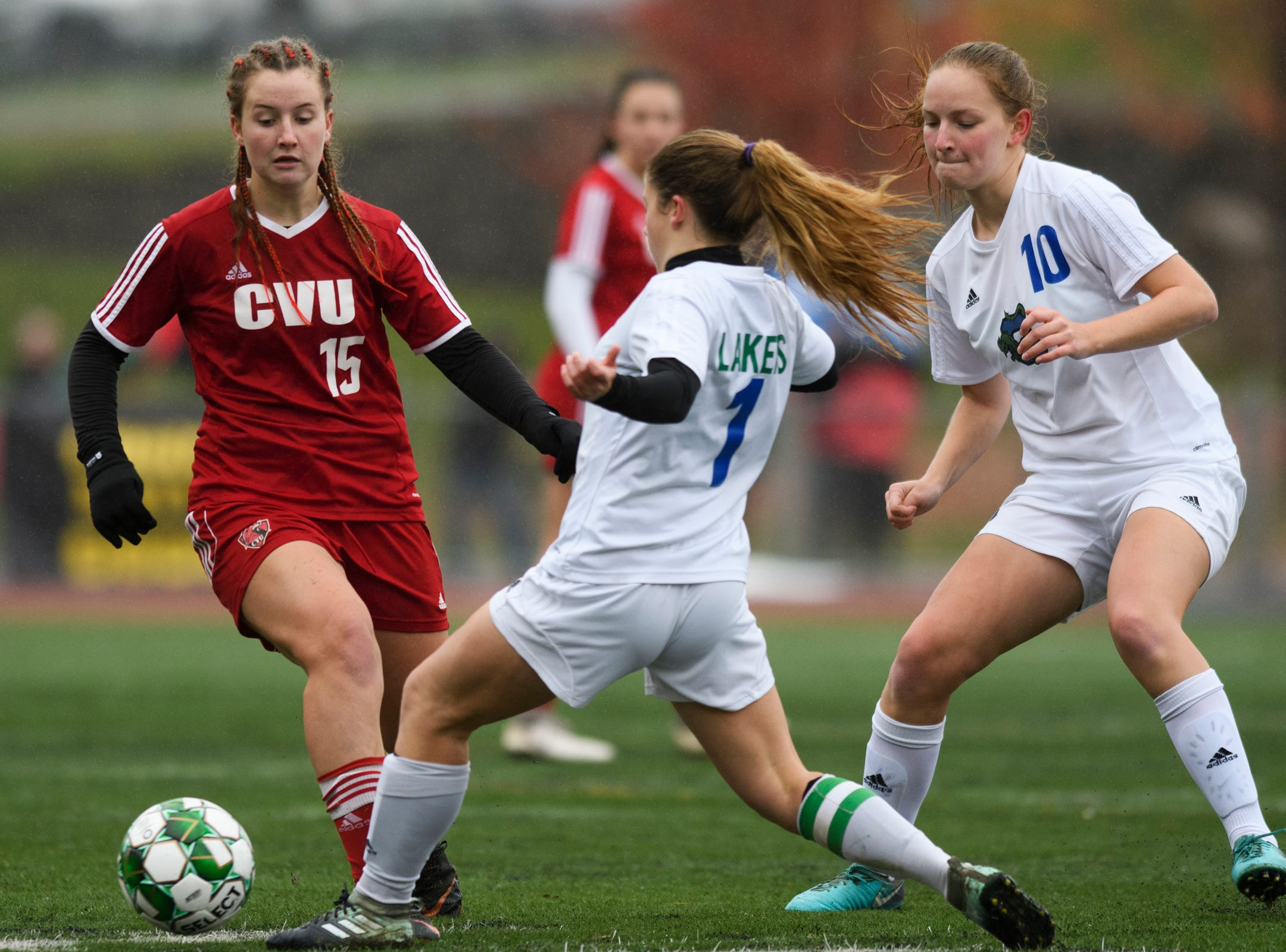 Colchester's Madison Finelli (1) battles for the ball with CVU's Olivia Morton (15) during the division I girls soccer championship game between the Colchester Lakers and the Champlain Valley Union Redhawks at Buck Hard Field on Saturday morning November 3, 2018 in Burlington.