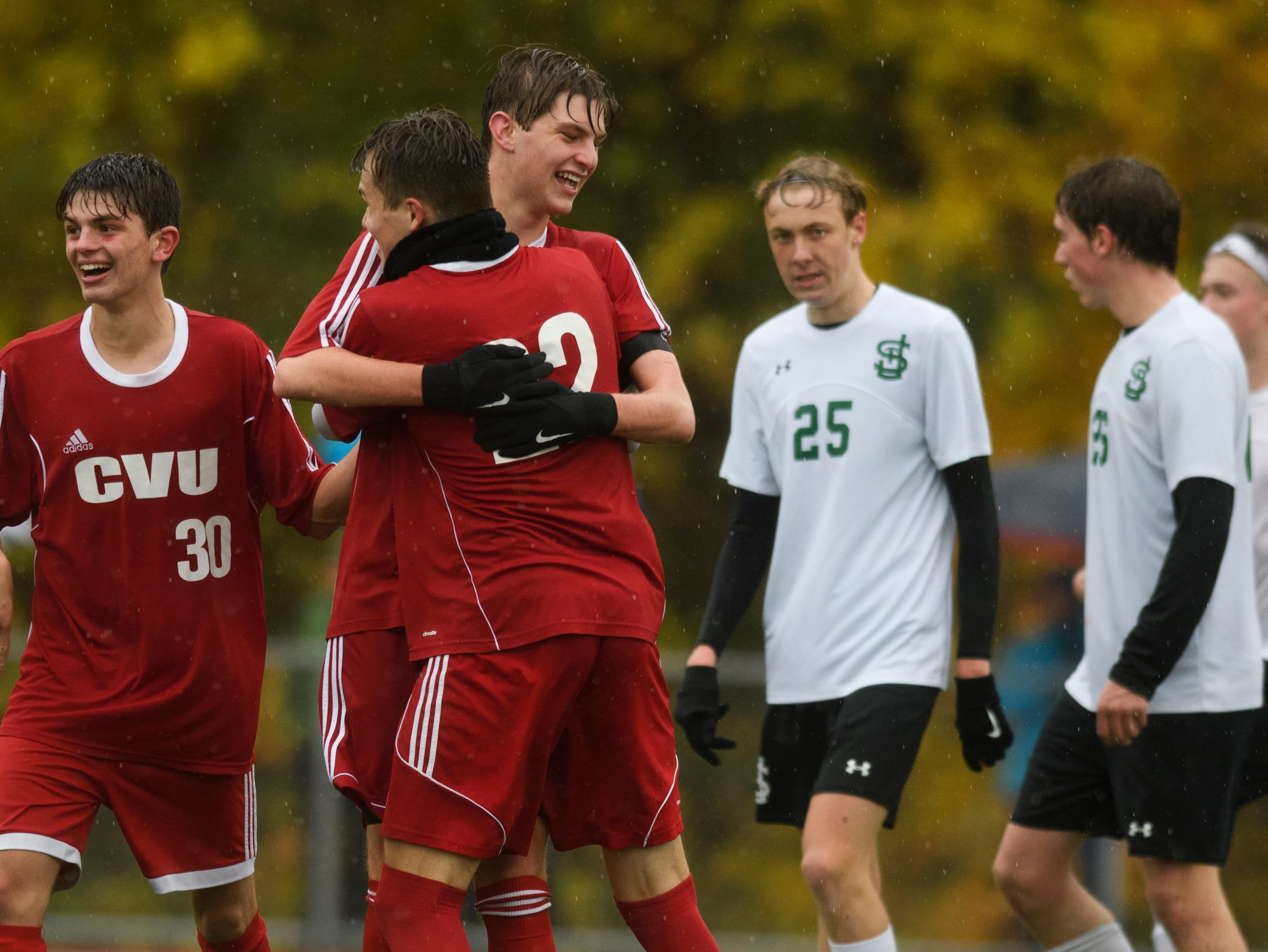 CVU celebrates a goal during the Division I boys soccer championship game between the St. Johnsbury Hilltoppers and the Champlain Valley Union Redhawks at Buck Hard Field on Saturday morning November 3, 2018 in Burlington.