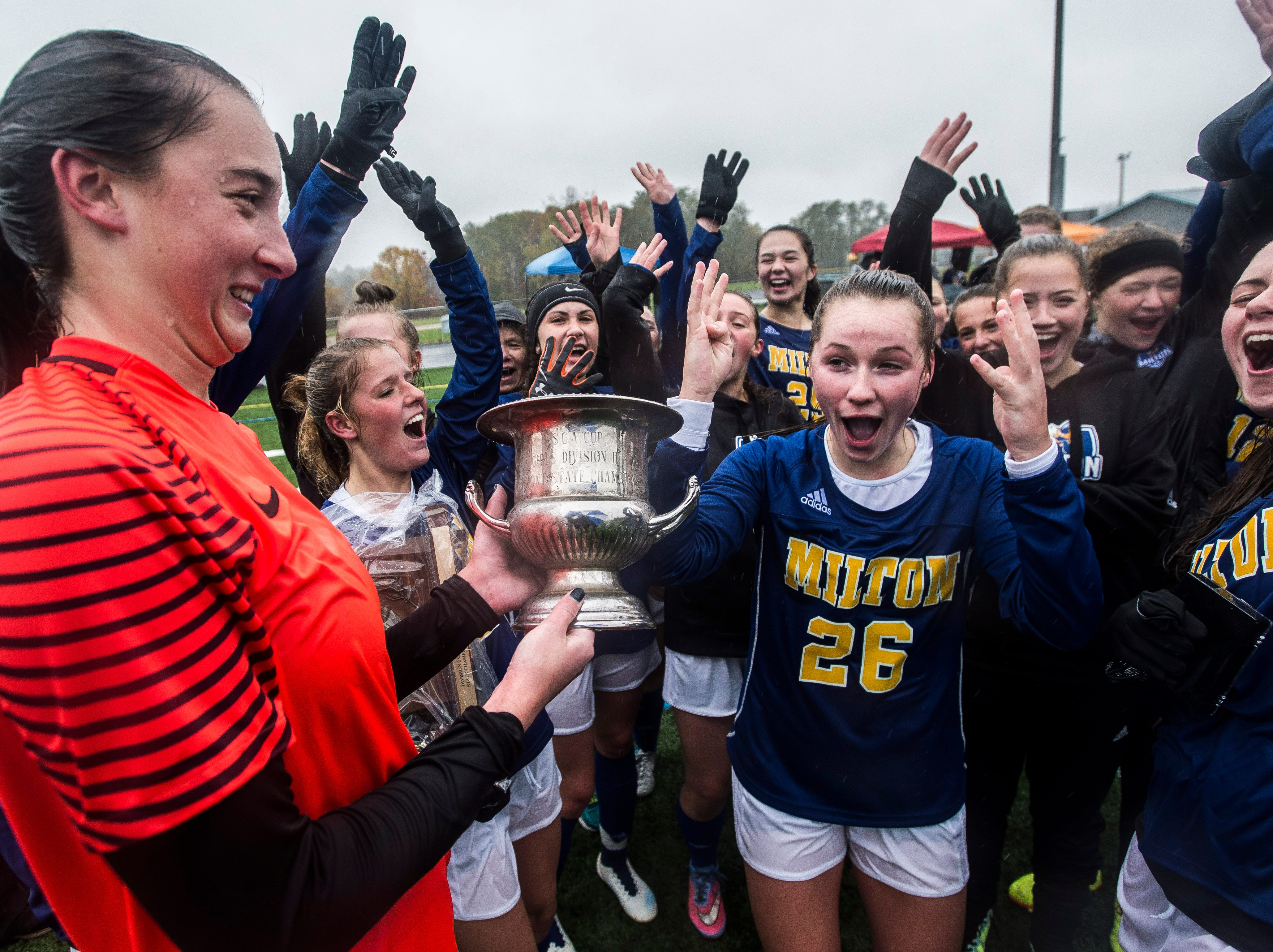 Milton girl's soccer celebrates their championship win over Rice after the Div. 2 Vermont State girl's high school soccer championship on Saturday, Nov. 3, 2018, at South Burlington High School. Milton won the championship in sudden-death overtime, 2-1.