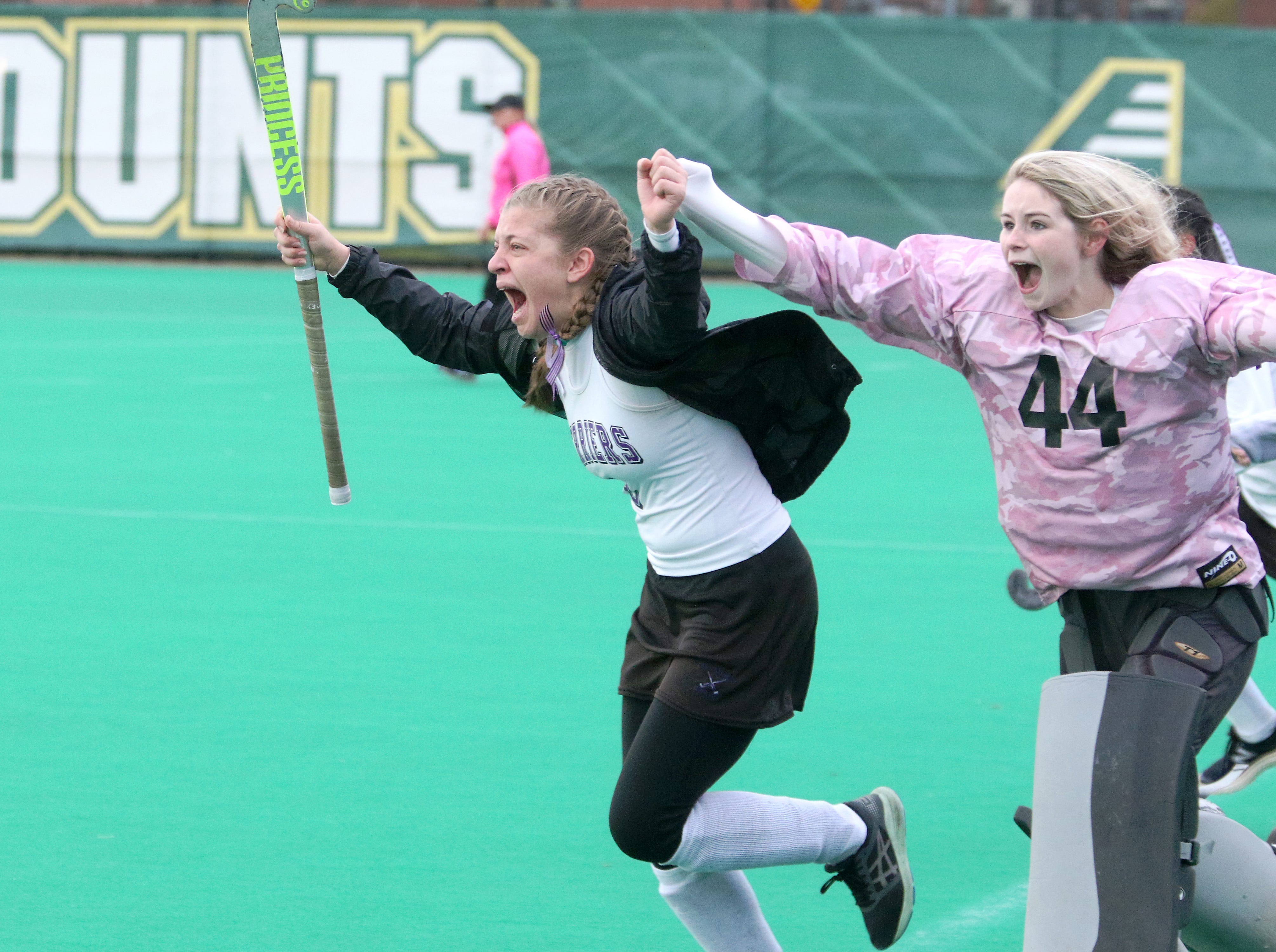 The thrill of victory! Junior Meagan Kelly and Senior Brigid Hodsden storm the field after defeating South Burlington 2-0 to claim the 2018 D1 State Championship.