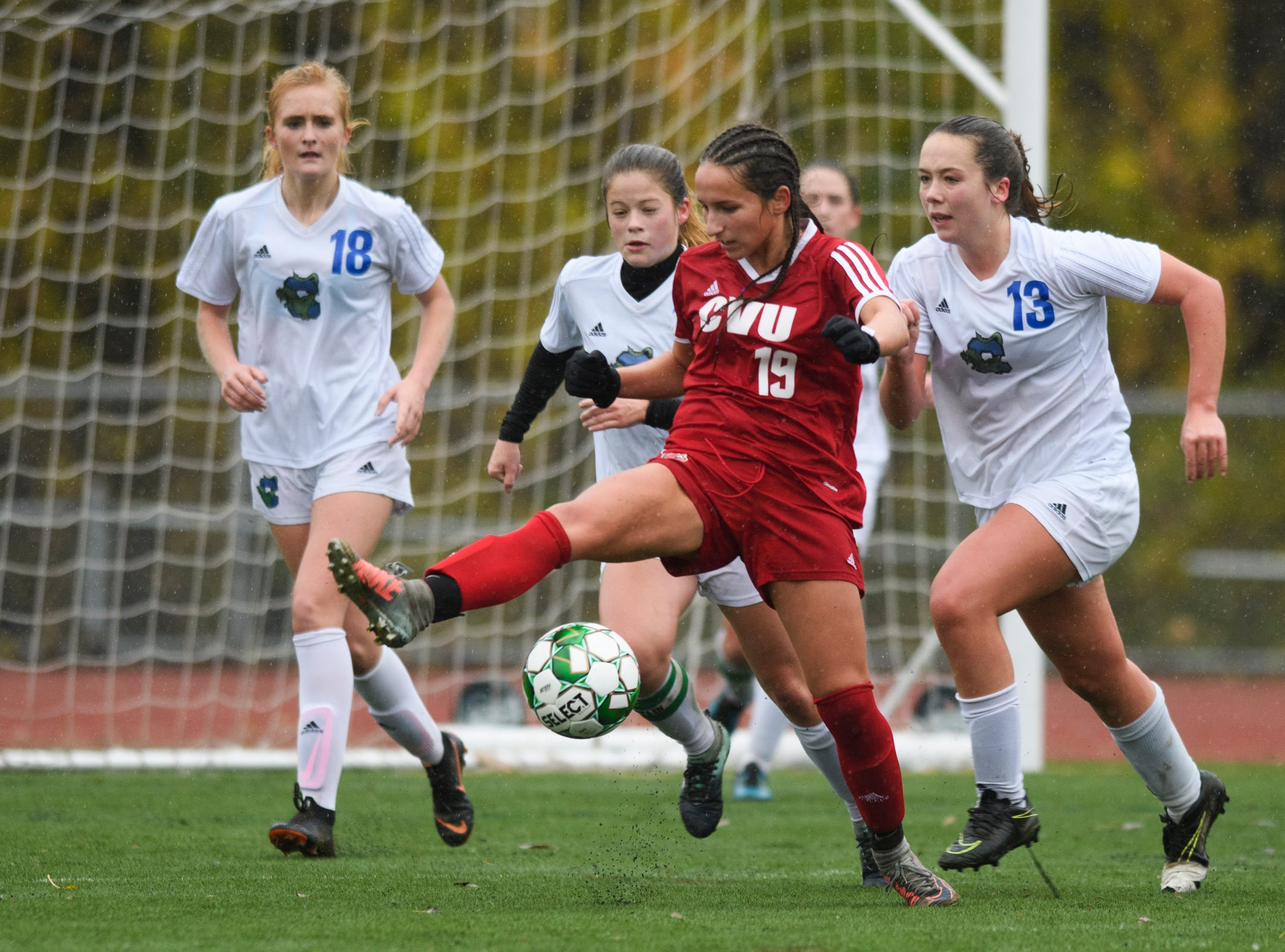 CVU's Sara Kelley (19) plays the ball in front of the net during the division I girls soccer championship game between the Colchester Lakers and the Champlain Valley Union Redhawks at Buck Hard Field on Saturday morning November 3, 2018 in Burlington.