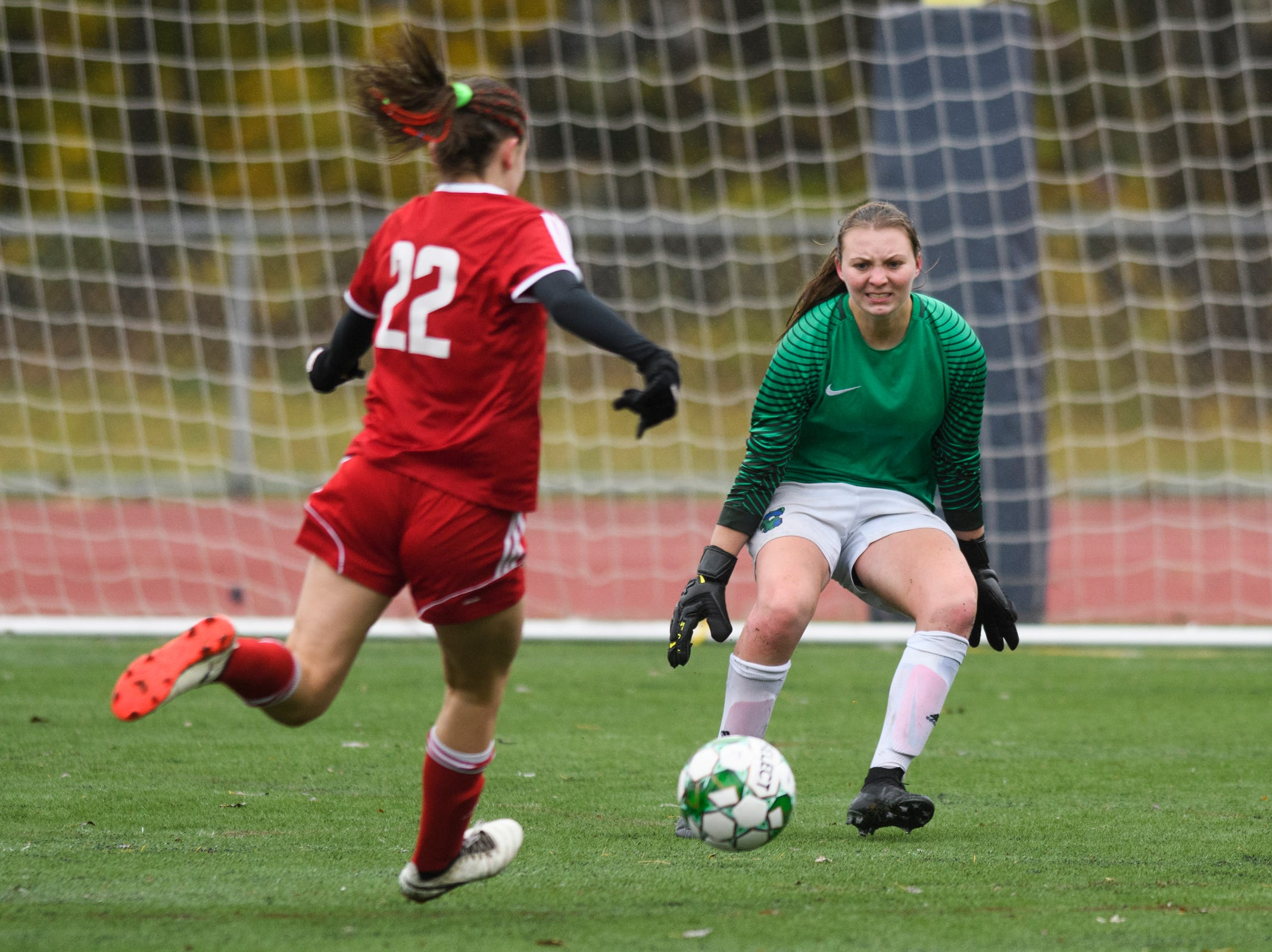 Colchester goalie Olivia Moore looks to make a save on a shot by CVU's Josie Pecor (22) during the division I girls soccer championship game between the Colchester Lakers and the Champlain Valley Union Redhawks at Buck Hard Field on Saturday morning November 3, 2018 in Burlington.