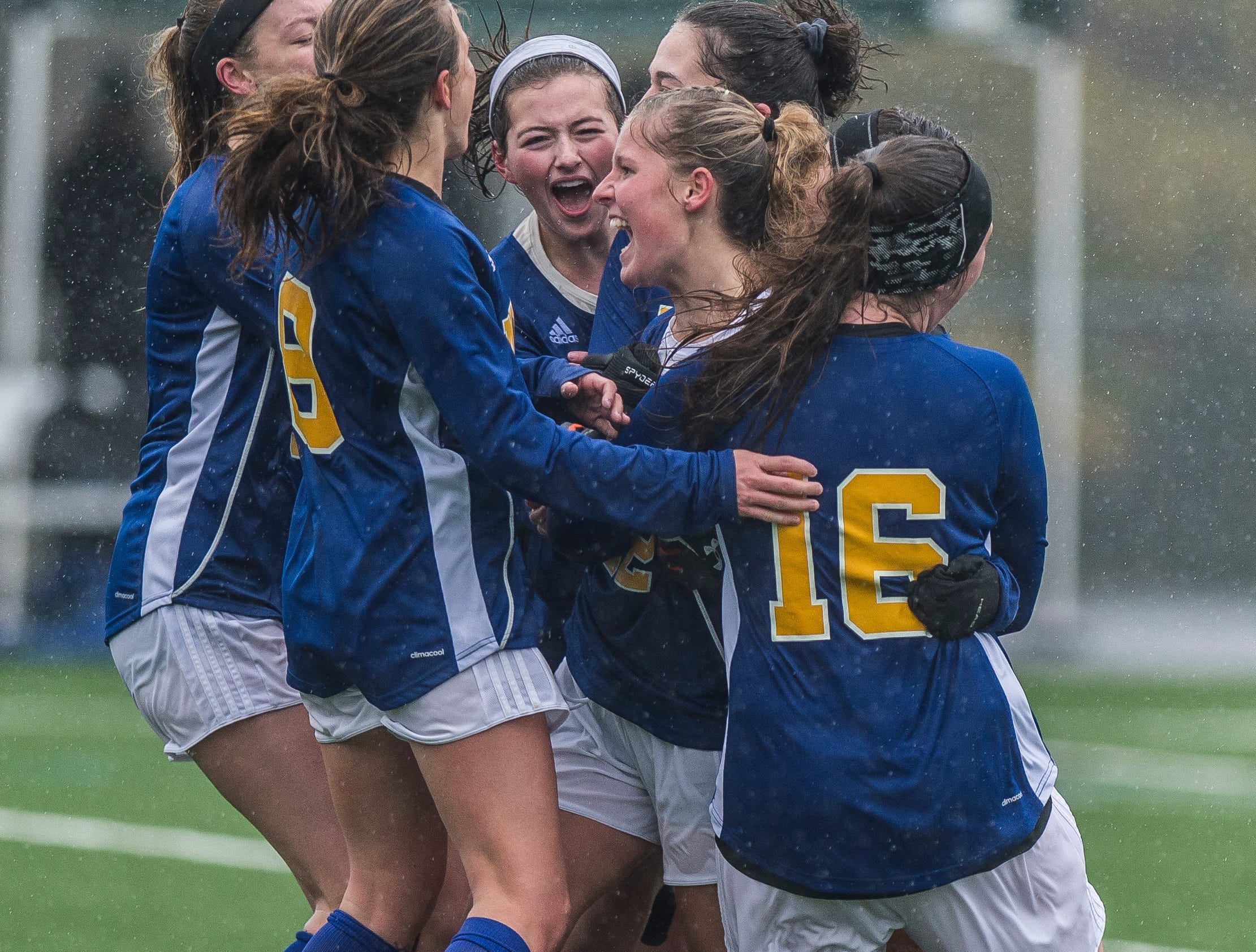 Milton #22 Tatum Shappy celebrates her championship-winning goal with teammates during the Div. 2 Vermont State girl's high school soccer championship on Saturday, Nov. 3, 2018, at South Burlington High School. Milton won the championship in sudden-death overtime, 2-1.