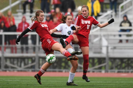 Colchester's Emma Corriveau (13) battles for the ball with CVU's Olivia Morton (15) and Sydney Jimmo (10) during the division I girls soccer championship game between the Colchester Lakers and the Champlain Valley Union Redhawks at Buck Hard Field on Saturday morning November 3, 2018 in Burlington.