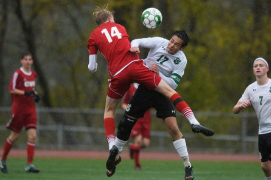 CVU's James Schmidt (14) and St. Johnsbury's Alex Gingue (17) battle to head the ball during the Division I boys soccer championship game between the St. Johnsbury Hilltoppers and the Champlain Valley Union Redhawks at Buck Hard Field on Saturday morning November 3, 2018 in Burlington.