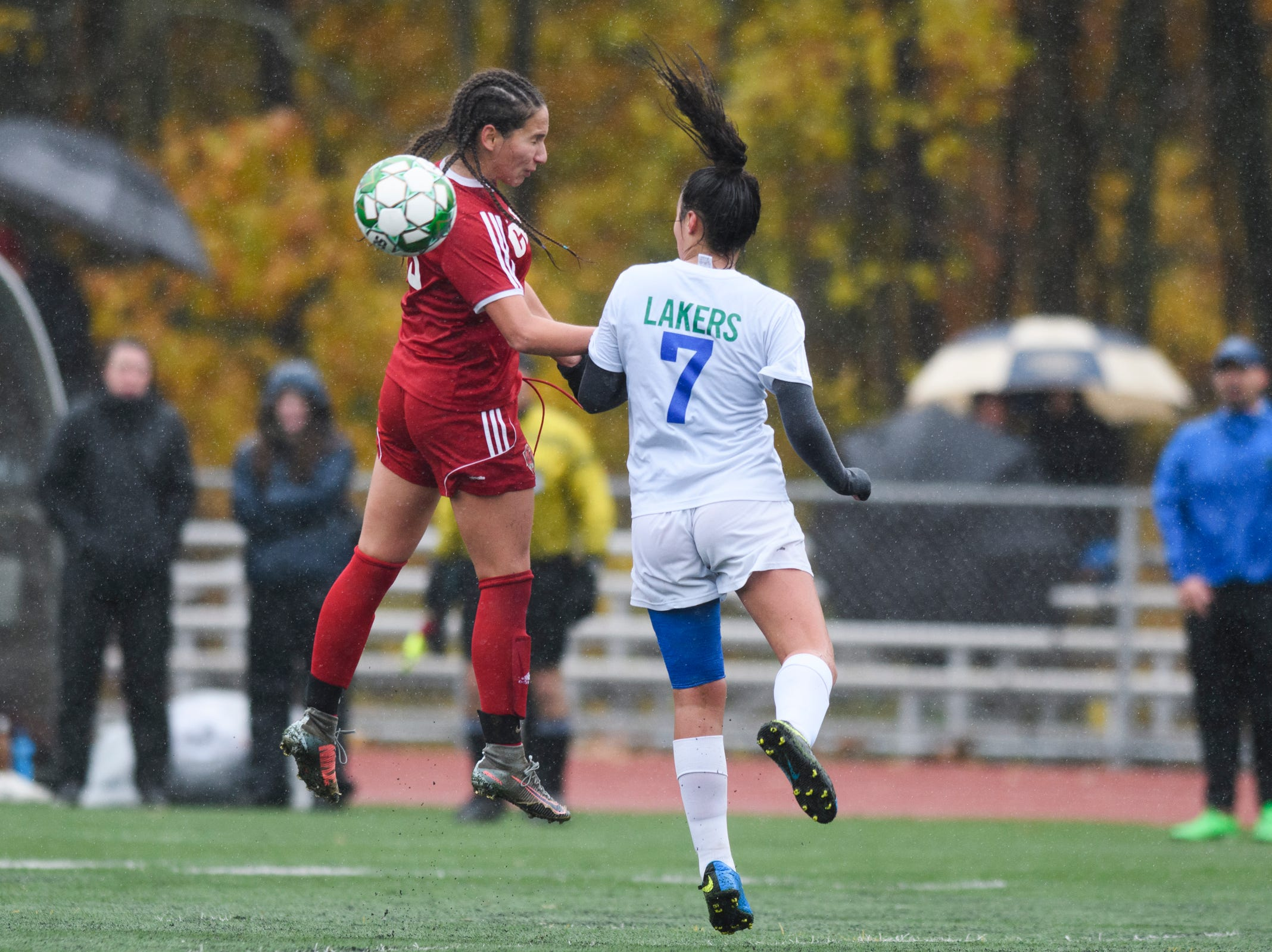 CVU's Sara Kelley (19) leaps over Colchester's Hailey Desautels (7) to head the ball during the division I girls soccer championship game between the Colchester Lakers and the Champlain Valley Union Redhawks at Buck Hard Field on Saturday morning November 3, 2018 in Burlington.