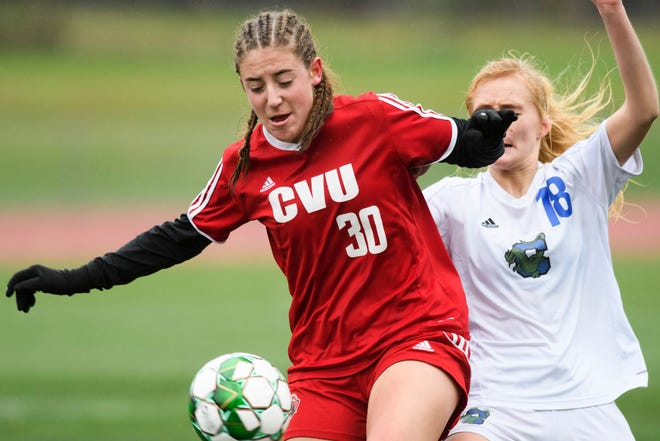 CVU's Olivia Zubarik (30) battles for the ball with Colchester's Brooke Booska (18) during the division I girls soccer championship game between the Colchester Lakers and the Champlain Valley Union Redhawks at Buck Hard Field on Saturday morning November 3, 2018 in Burlington.