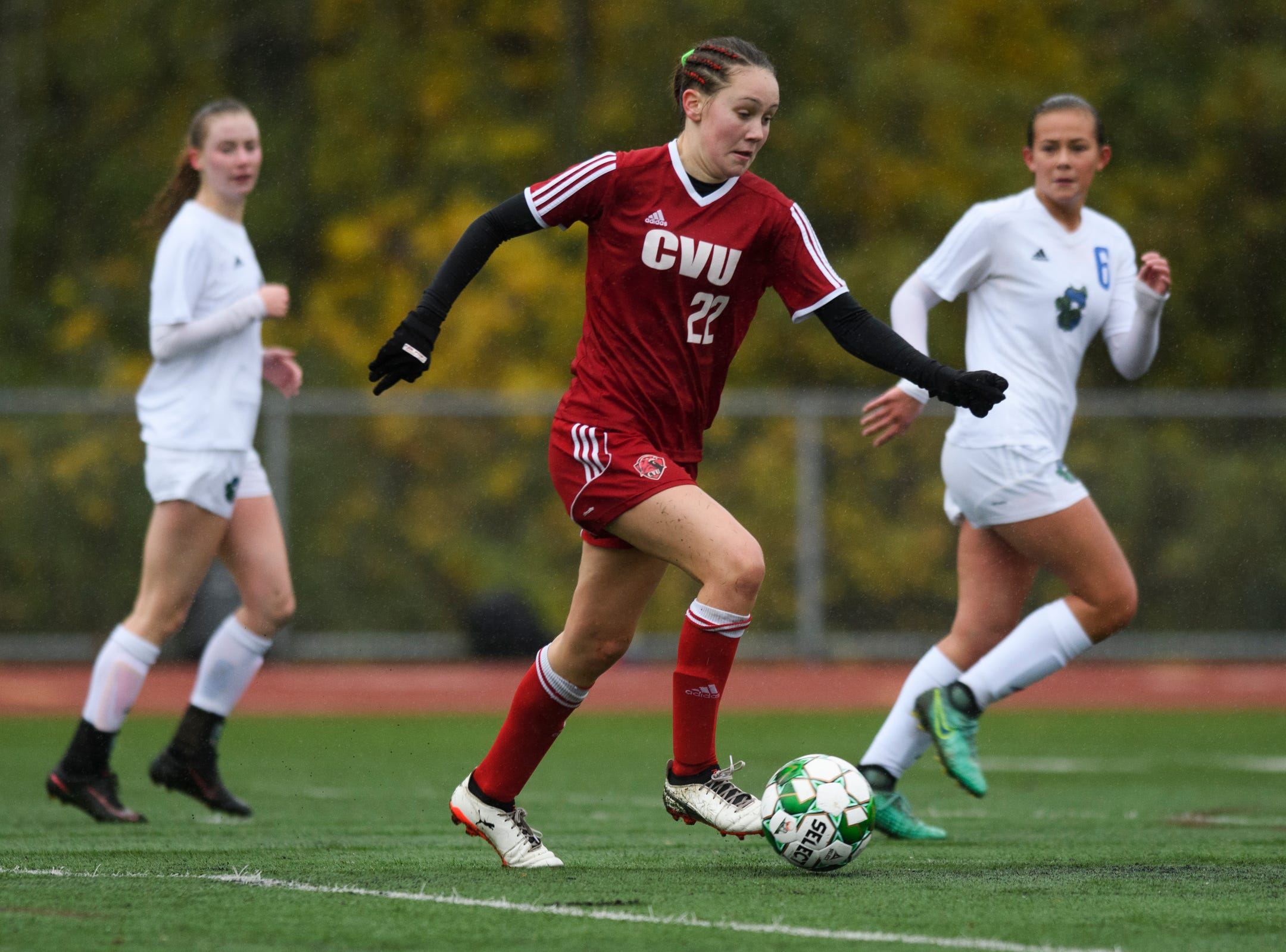 CVU's Josie Pecor (22) runs down the field with the ball during the division I girls soccer championship game between the Colchester Lakers and the Champlain Valley Union Redhawks at Buck Hard Field on Saturday morning November 3, 2018 in Burlington.