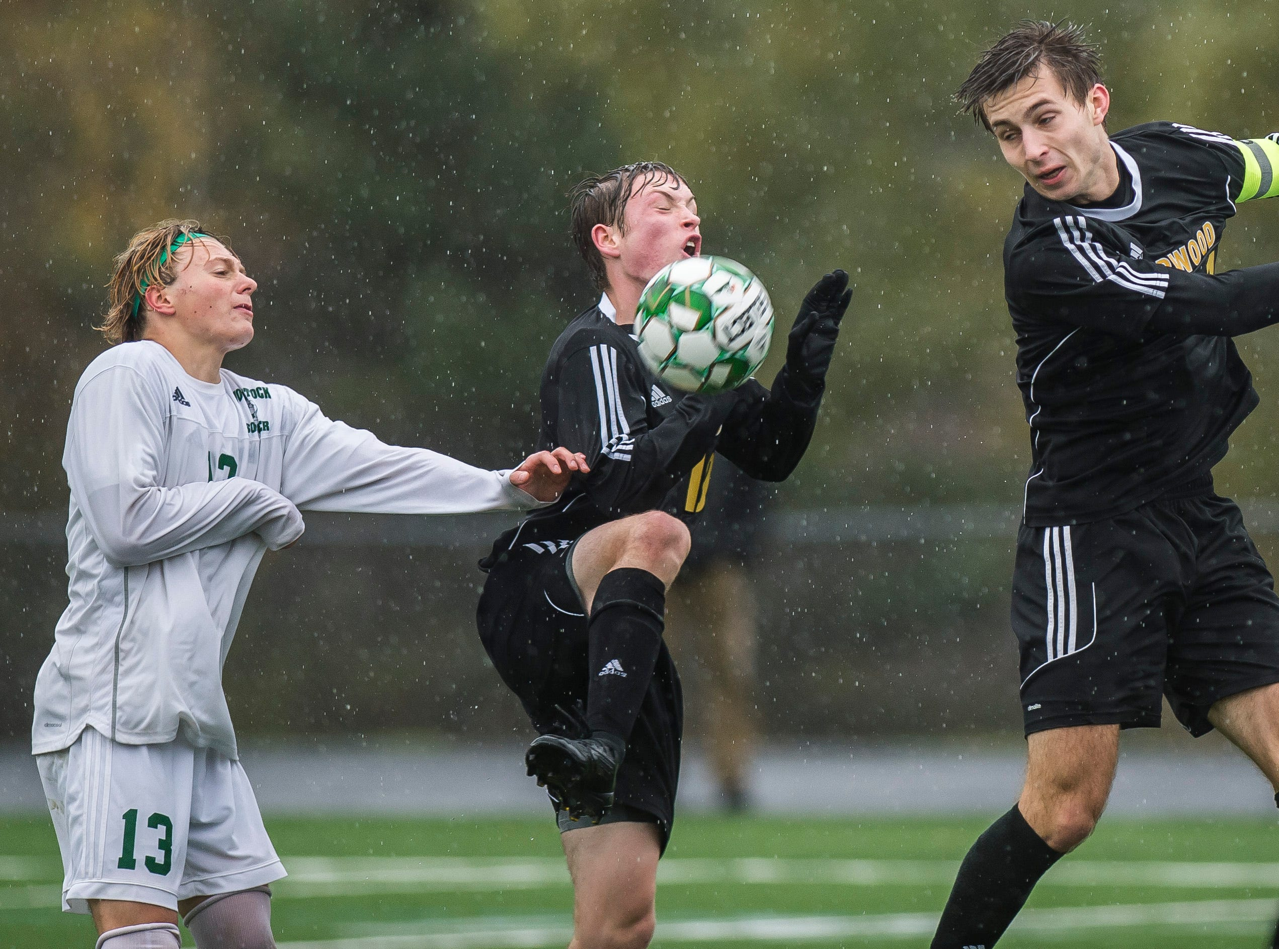 Woodstock #13 Isaac Emery and Harwood #19 Duncan Weinman and  #14 Wyatt Adams all fight for the ball during their Div. 2 Vermont State high school boy's soccer championship game at South Burlington High School on Saturday, Nov. 3, 2018. Hardwood Union won, 3-0.