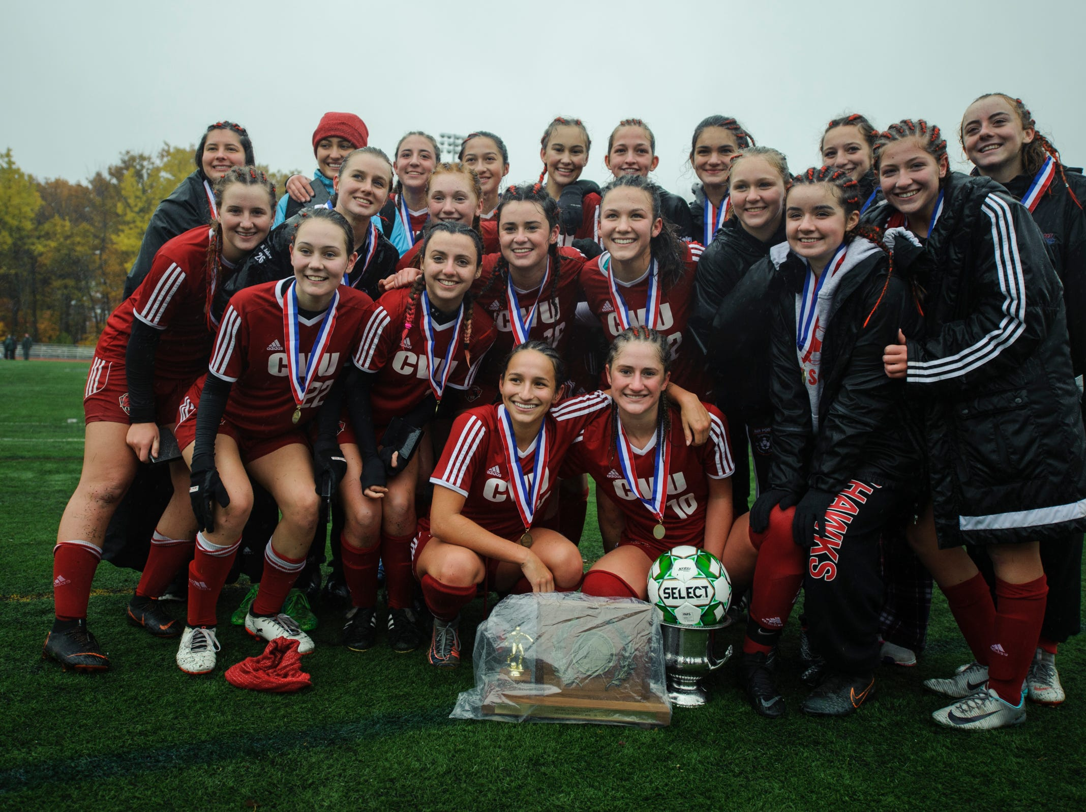 Champlain Valley players celebrate following their 1-0 win in the Division I girls soccer championship game between the Colchester Lakers and the Champlain Valley Union Redhawks at Buck Hard Field on Saturday morning November 3, 2018 in Burlington.
