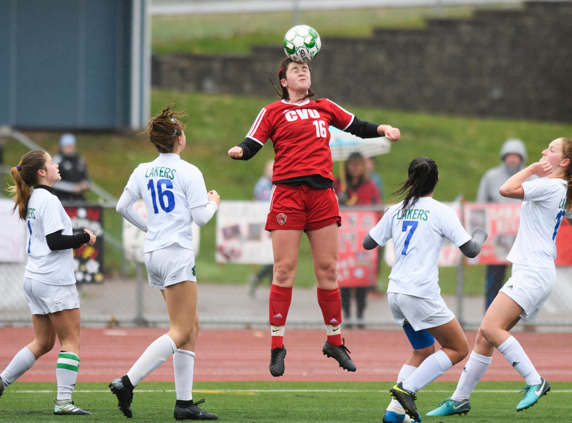 CVU's Ella Woodruff (16) leaps to head the ball during the division I girls soccer championship game between the Colchester Lakers and the Champlain Valley Union Redhawks at Buck Hard Field on Saturday morning November 3, 2018 in Burlington.