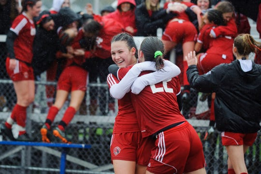 CVU celebrates the win during the division I girls soccer championship game between the Colchester Lakers and the Champlain Valley Union Redhawks at Buck Hard Field on Saturday morning November 3, 2018 in Burlington.